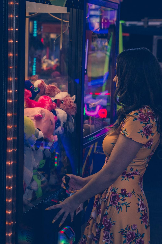 woman watching plush toy lot