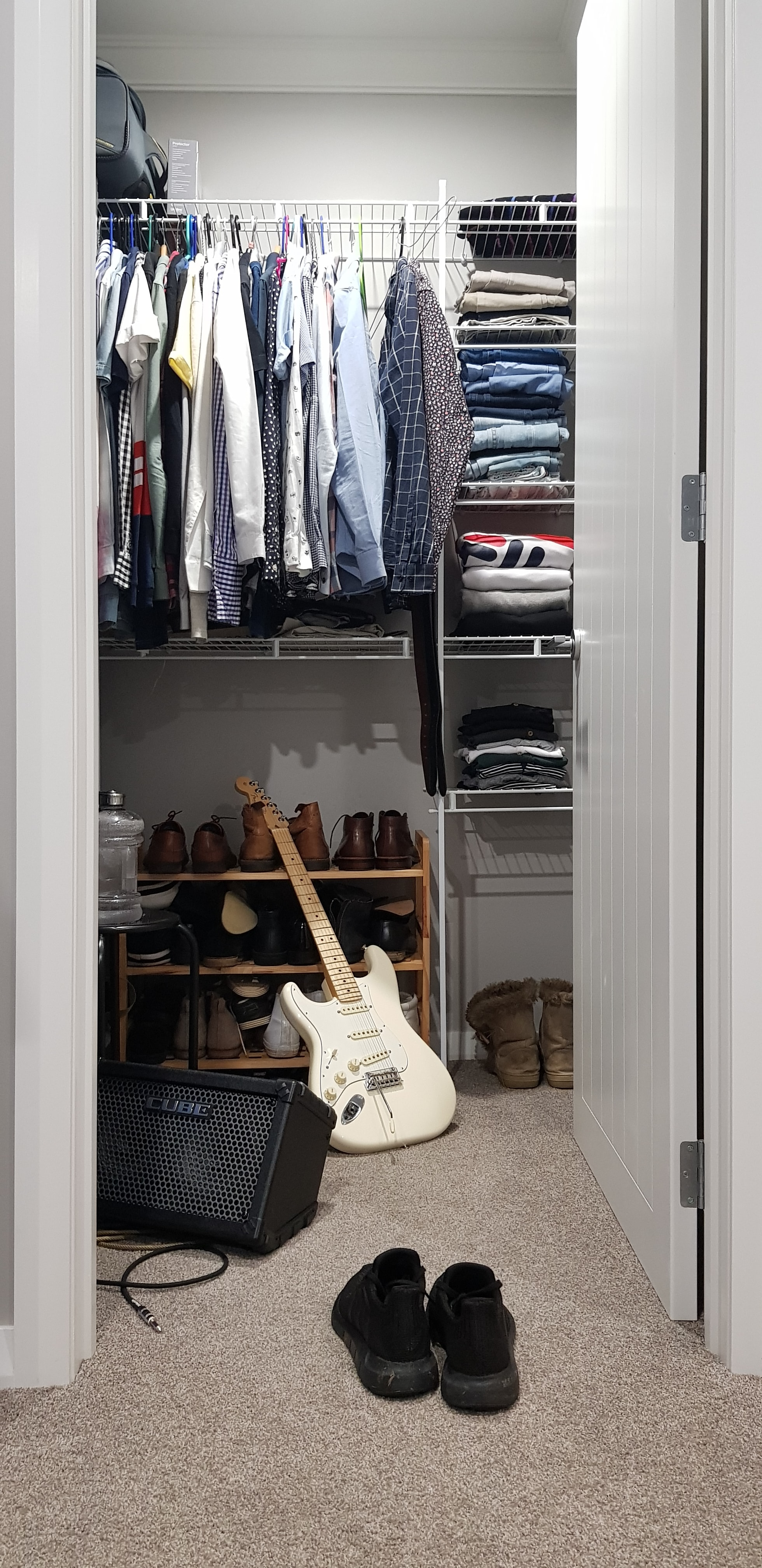 white electric guitar in closet