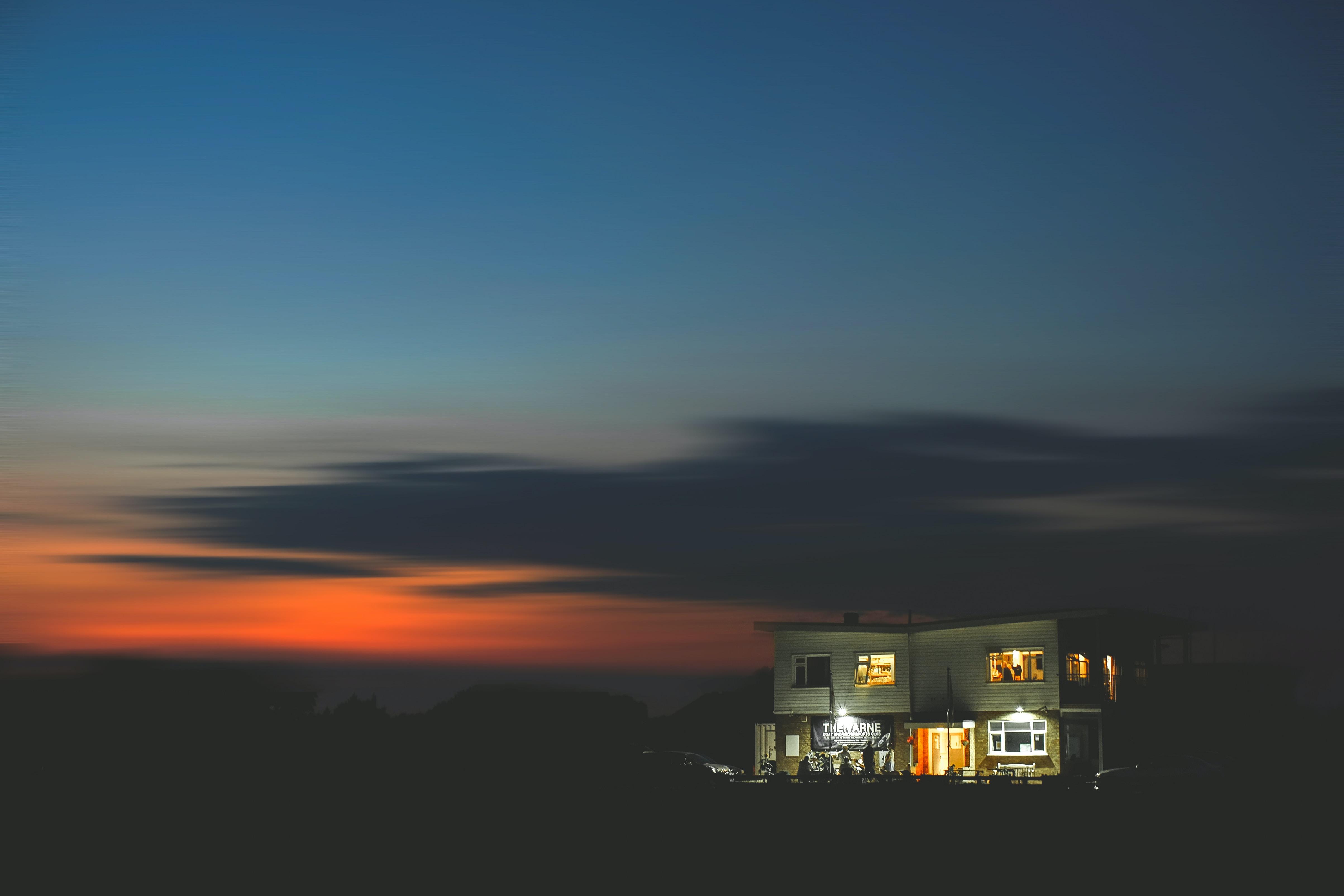 white lighted house during sunset