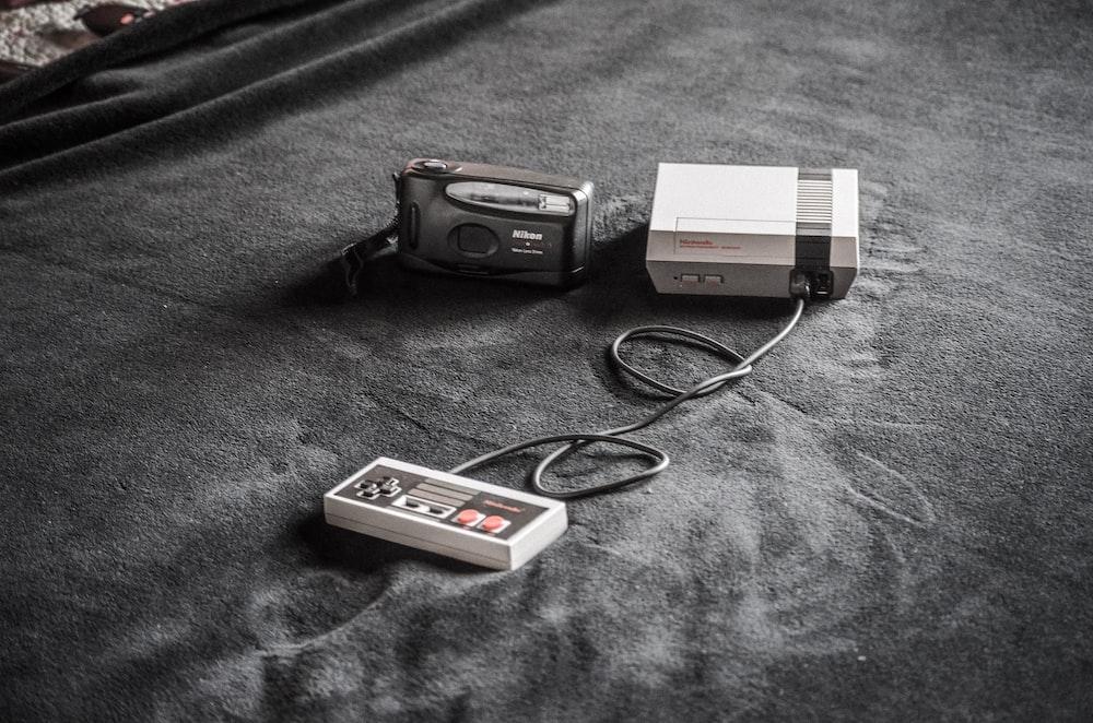 NES console beside black camera