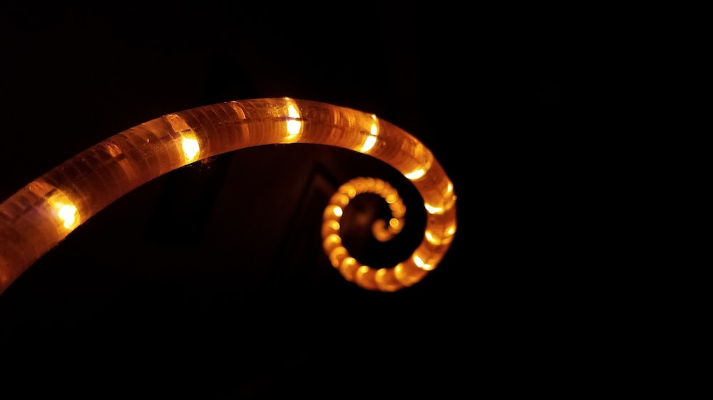 selective focus photography of brown spiraled LED light