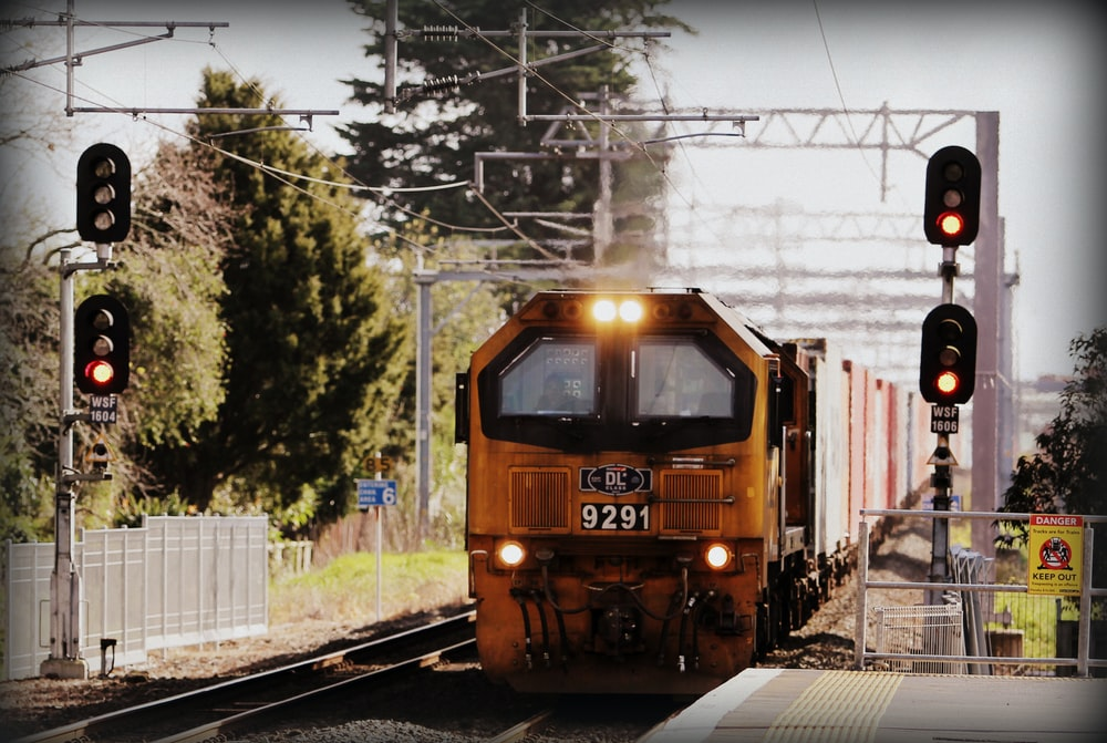 yellow train near platform