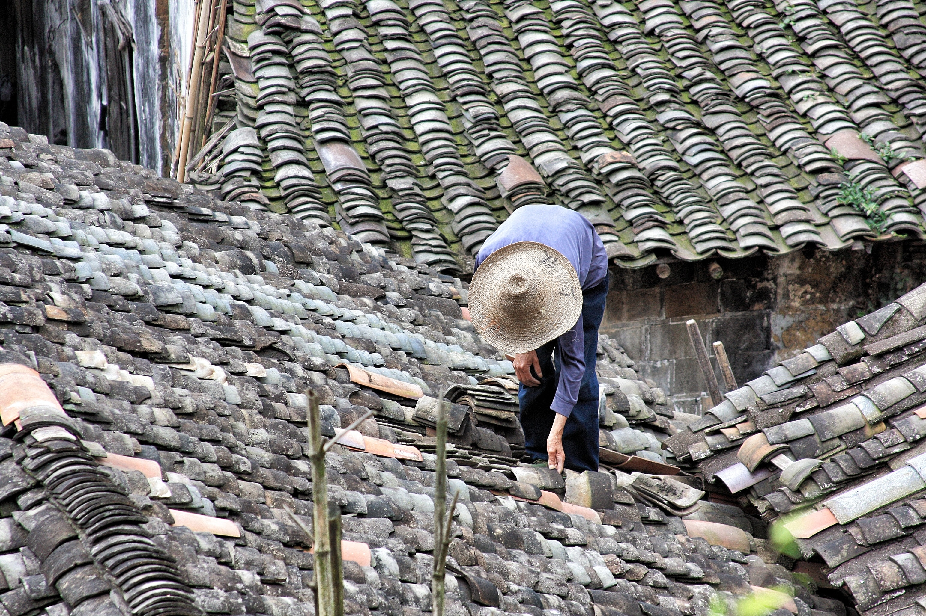 person standing on roof tiles