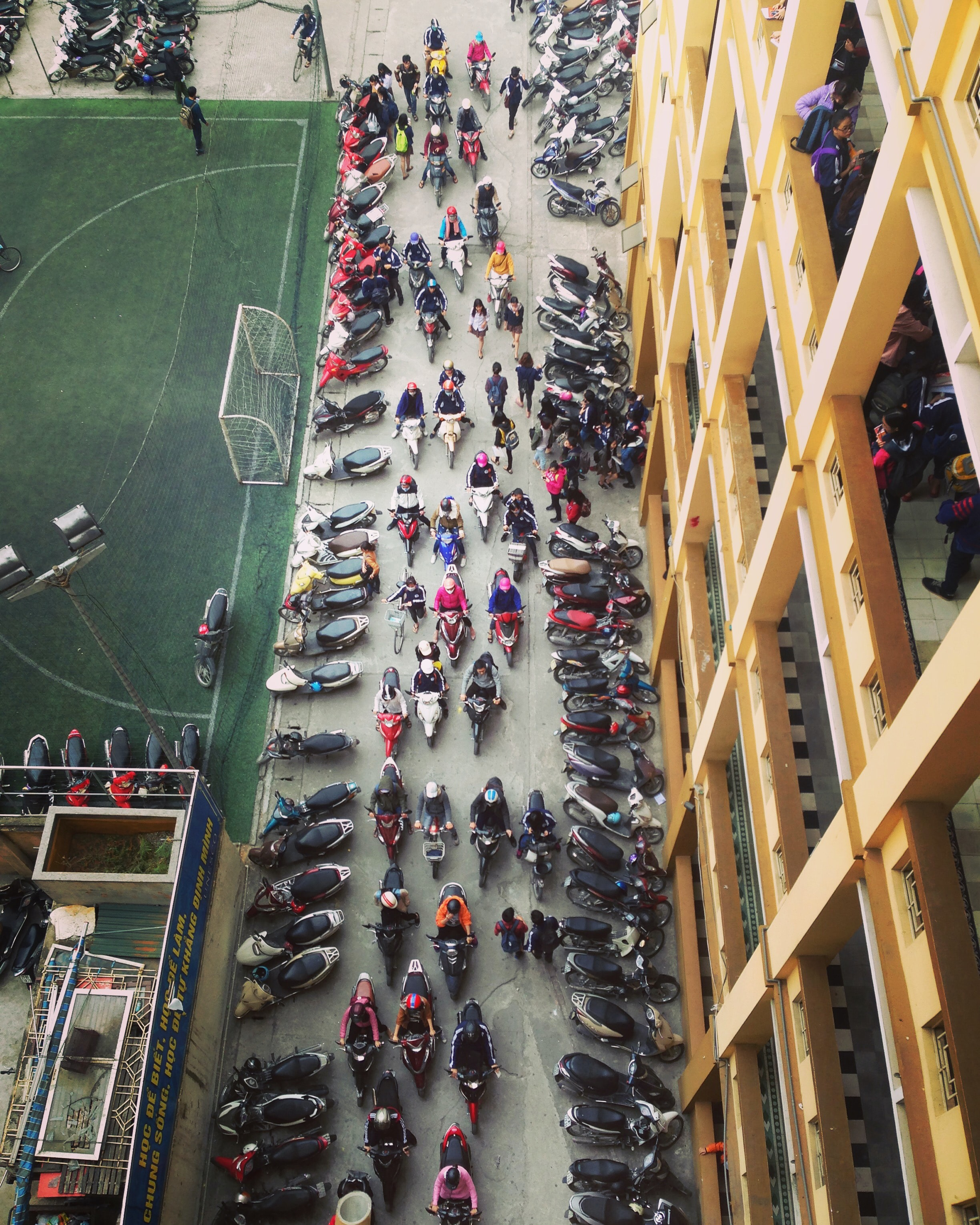 bird's-eye view photo of row of motorcycles on road