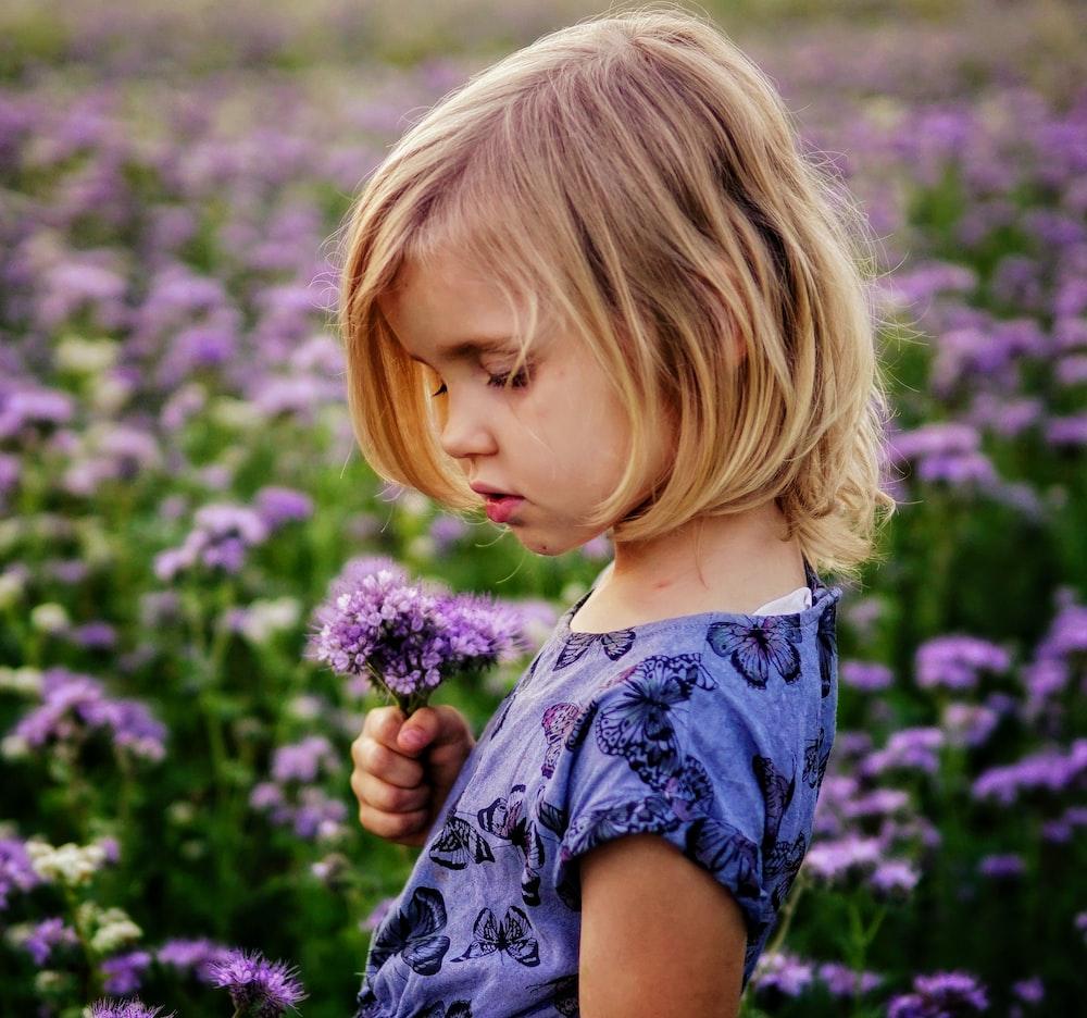 girl holding purple flowers