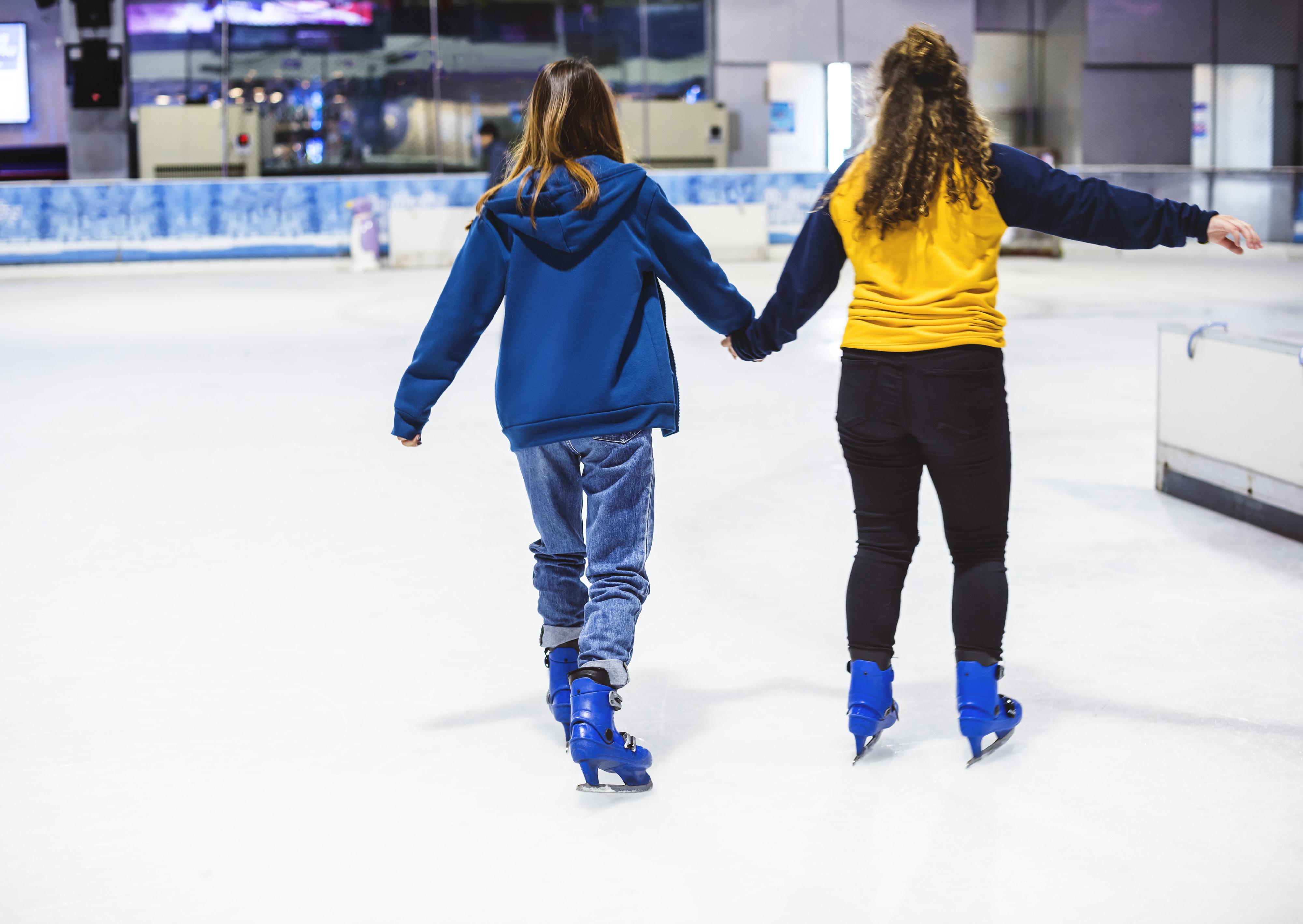 two girls ice skates