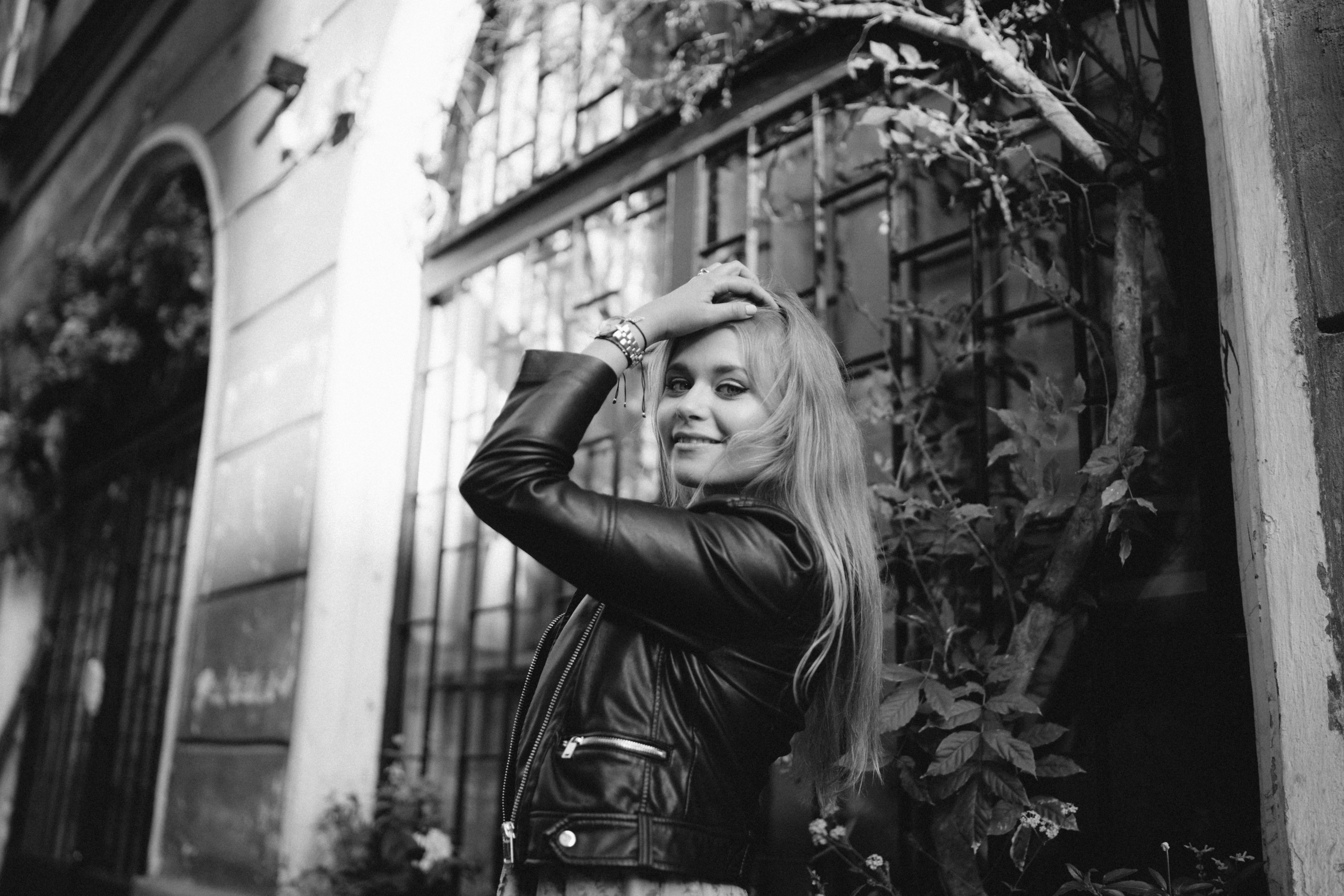 grayscale photo of woman wearing leather jacket