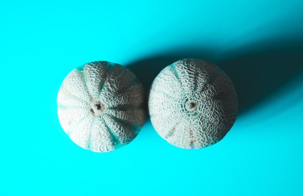 two grey fruits