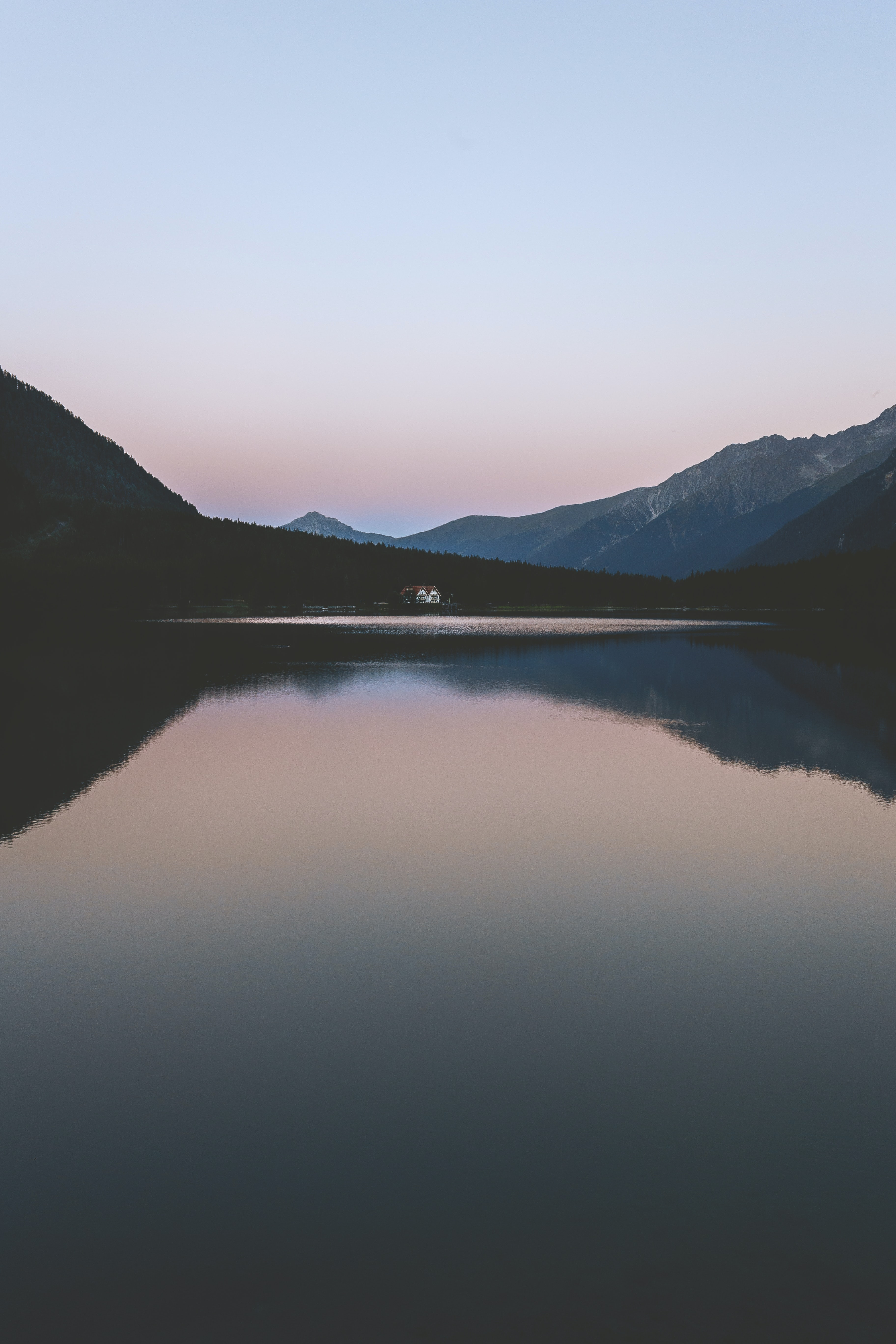 body of water in front of mountain