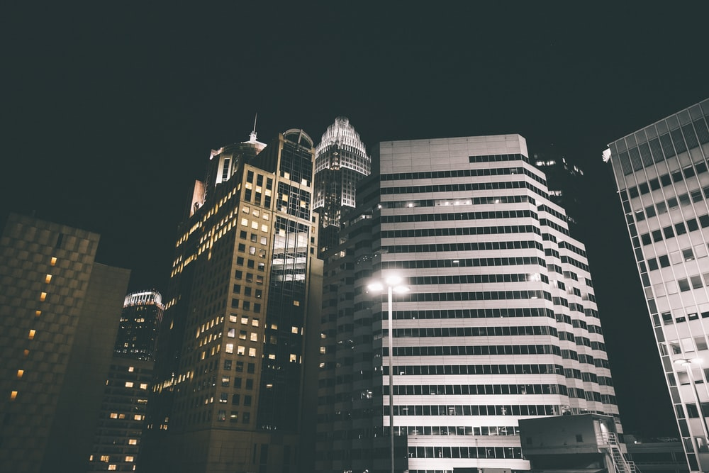 low angle photography of concrete buildings at night