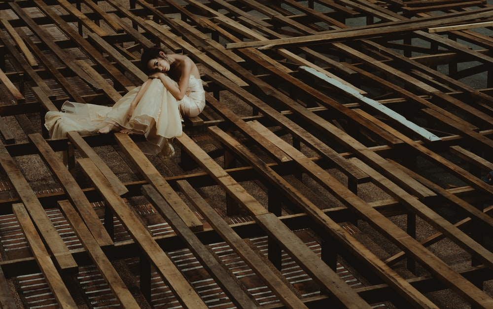 woman laying down on wooden structure
