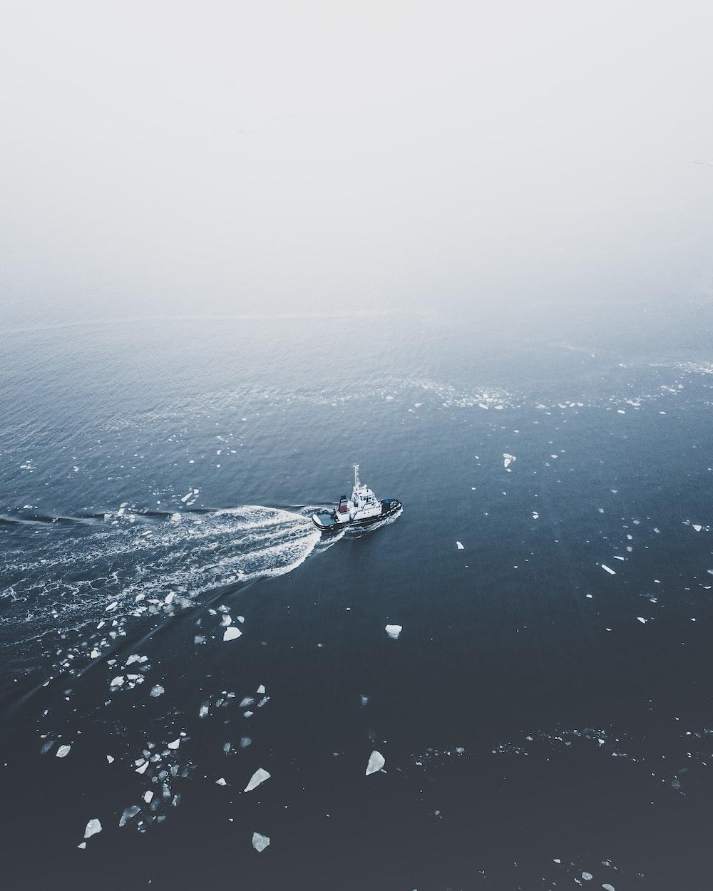 black coat on body of water