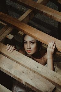 woman below brown wooden frames
