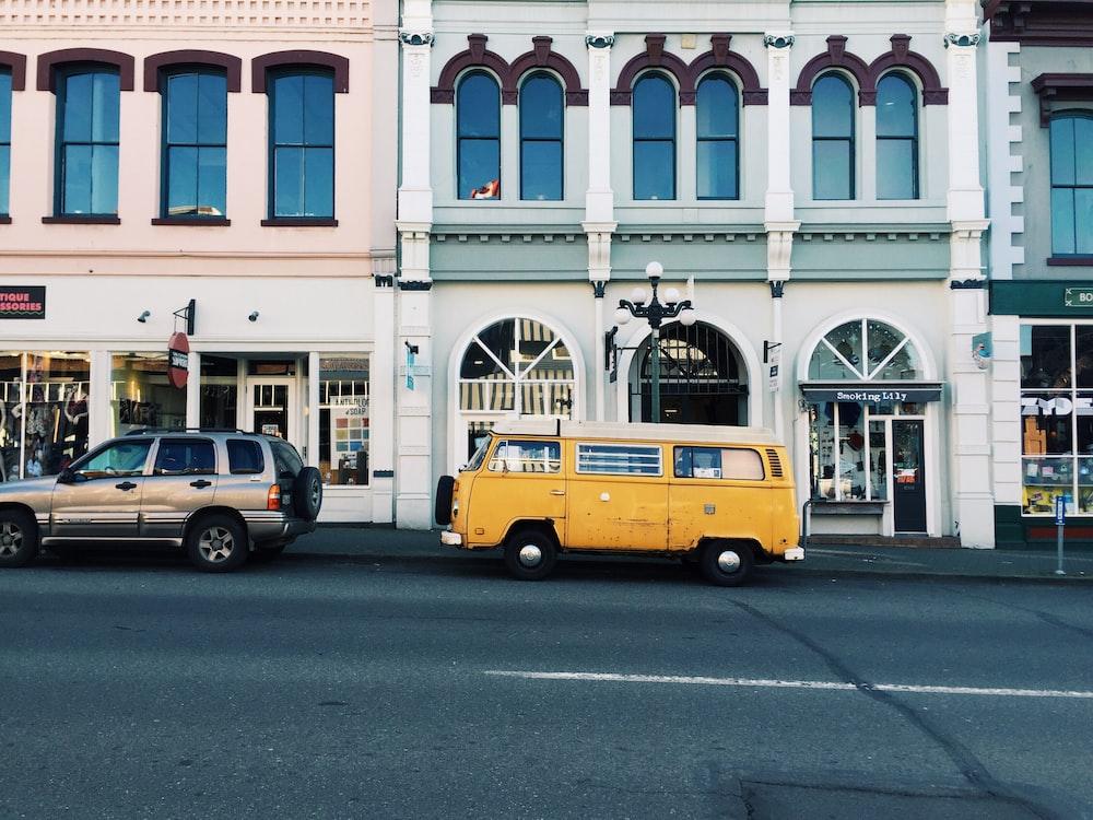yellow van behind silver SUV