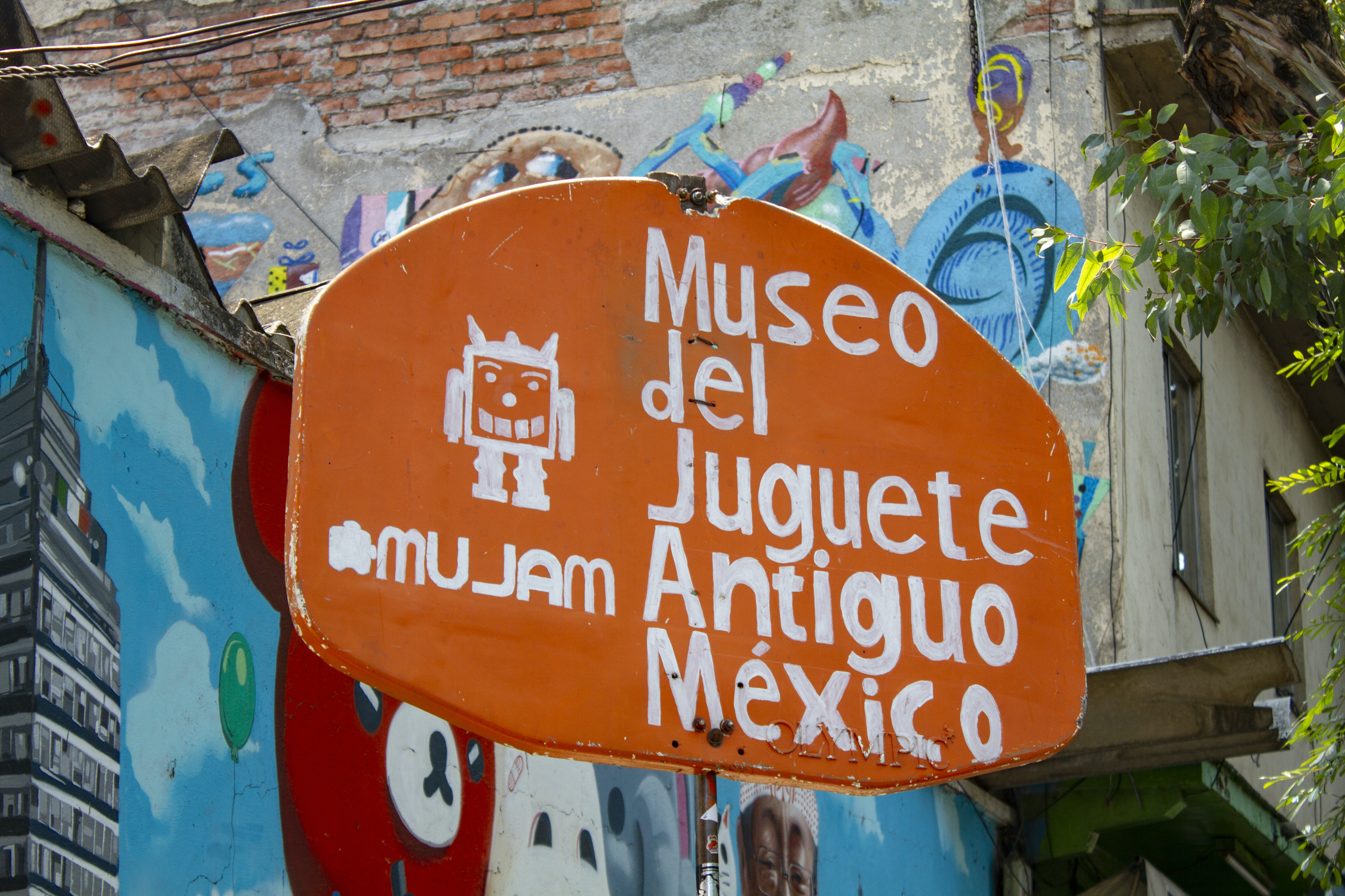 orange and white Museo del Juguete Antiguo Mexico signage
