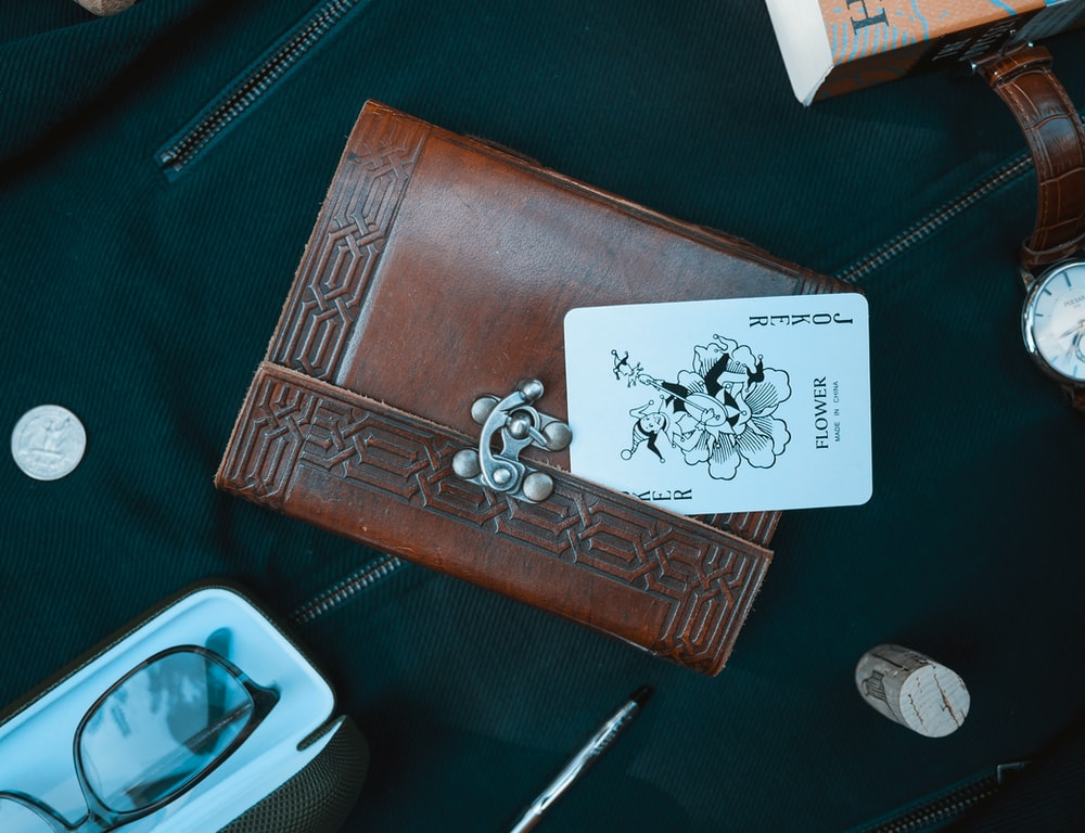 Joker card on brown leather wallet