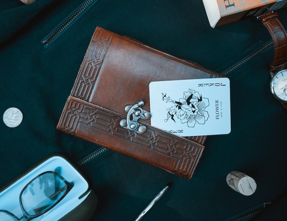 Joker card on brown leather wallet