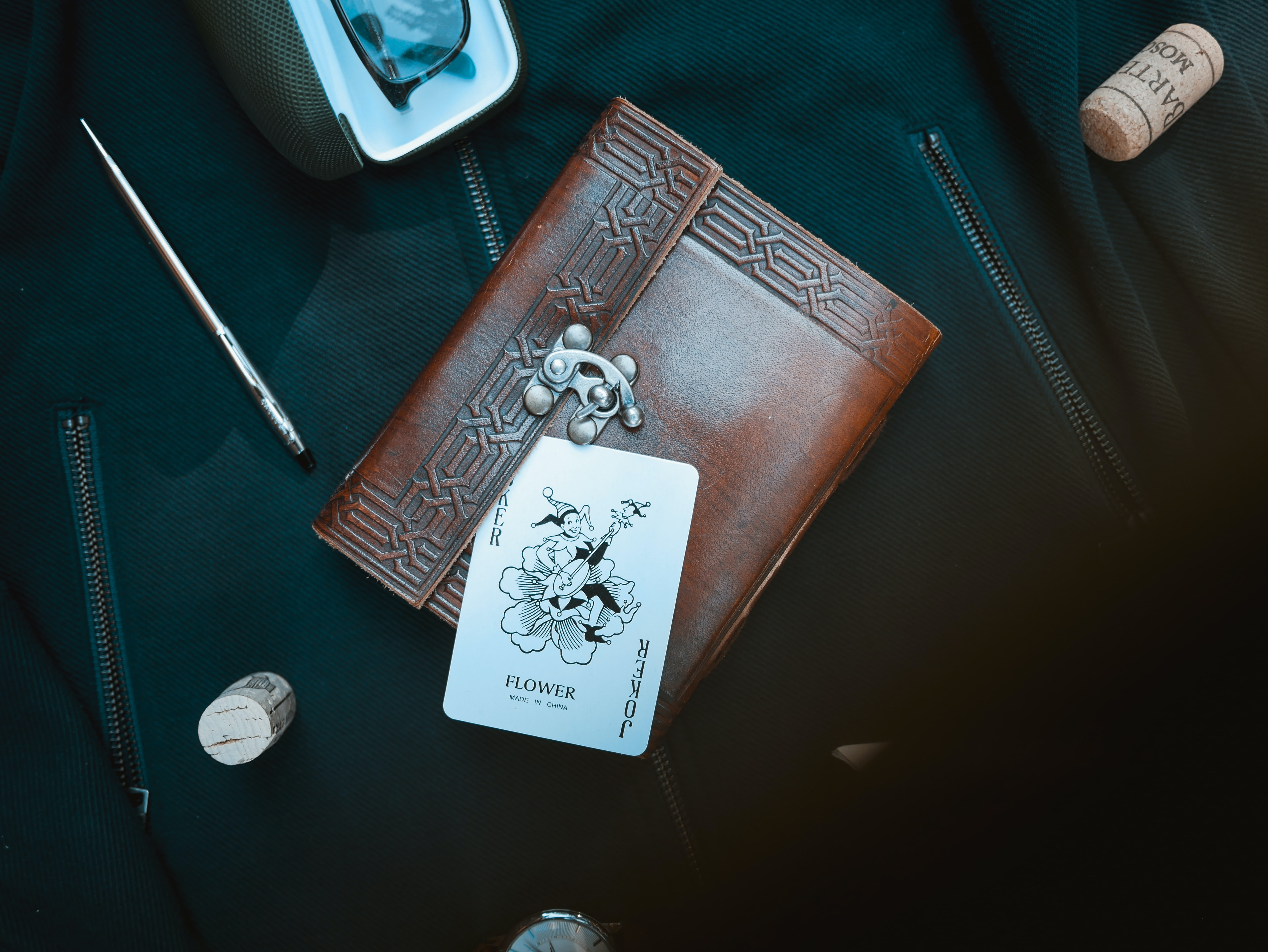 joker playing card on brown purse