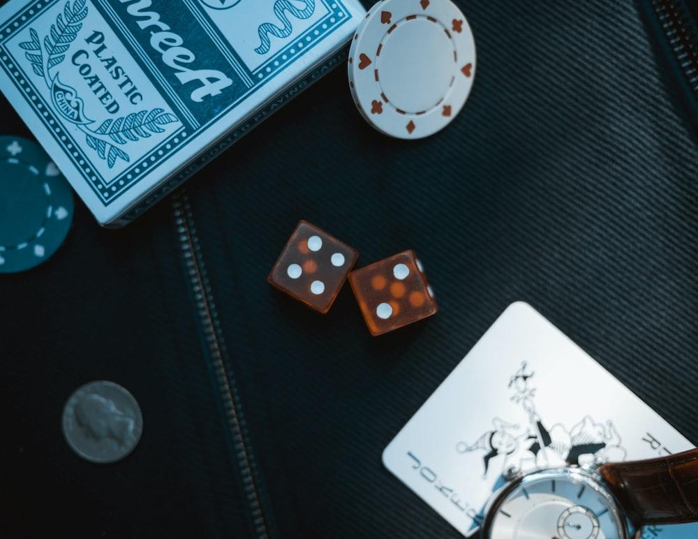two orange dice on black surface