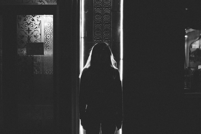 woman standing near door inside room