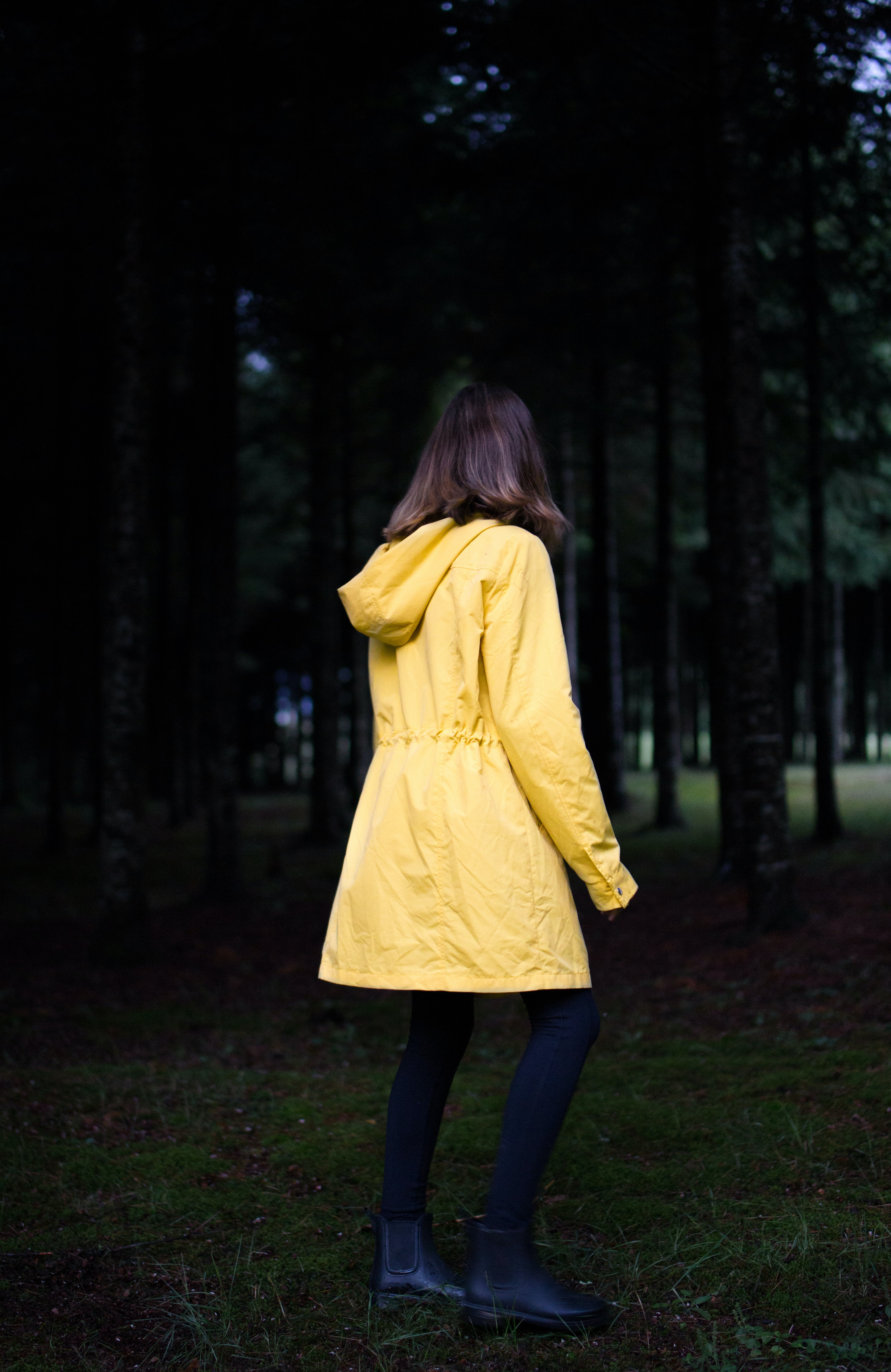 woman standing near green leafed trees