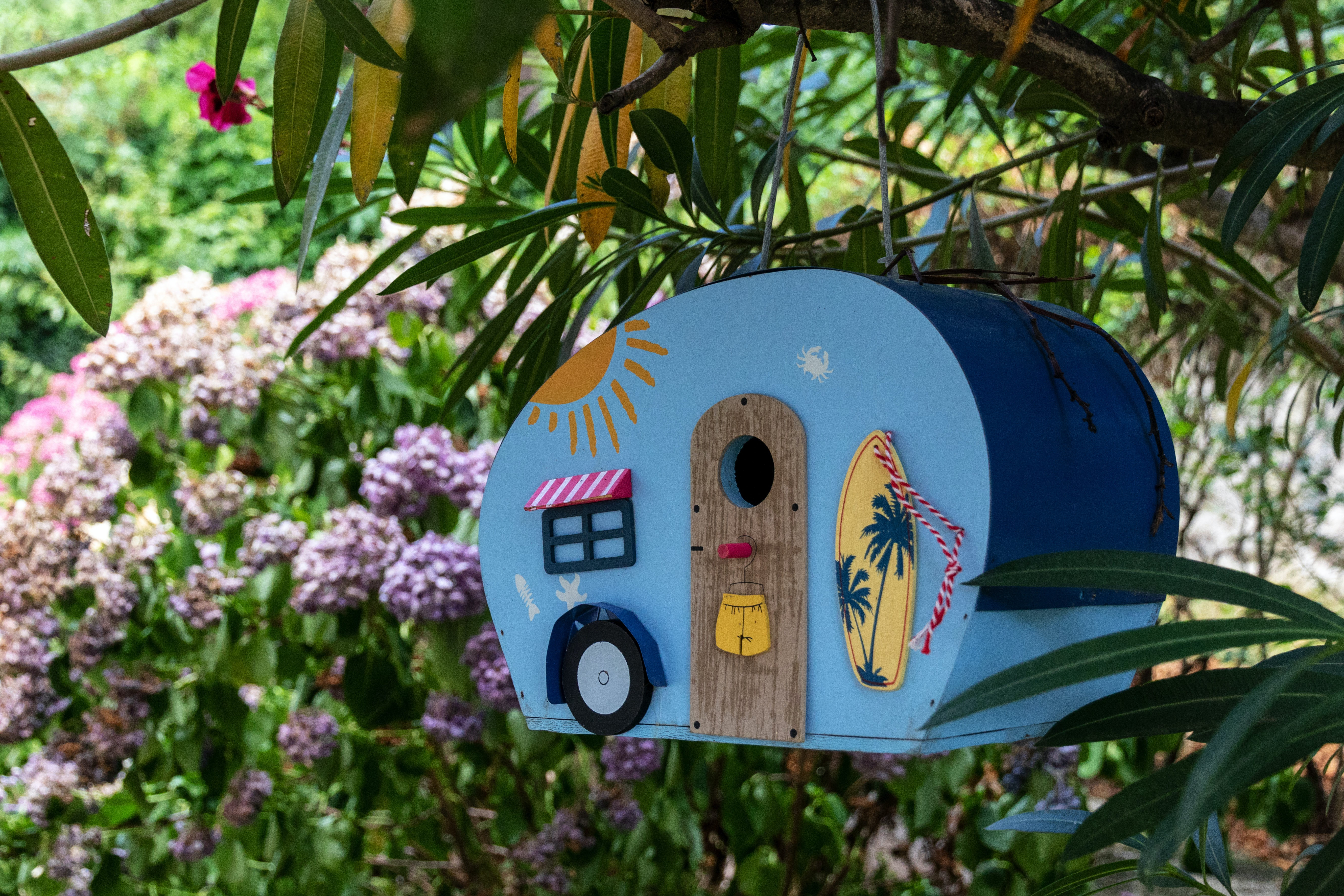 blue and multicolored wooden bird house
