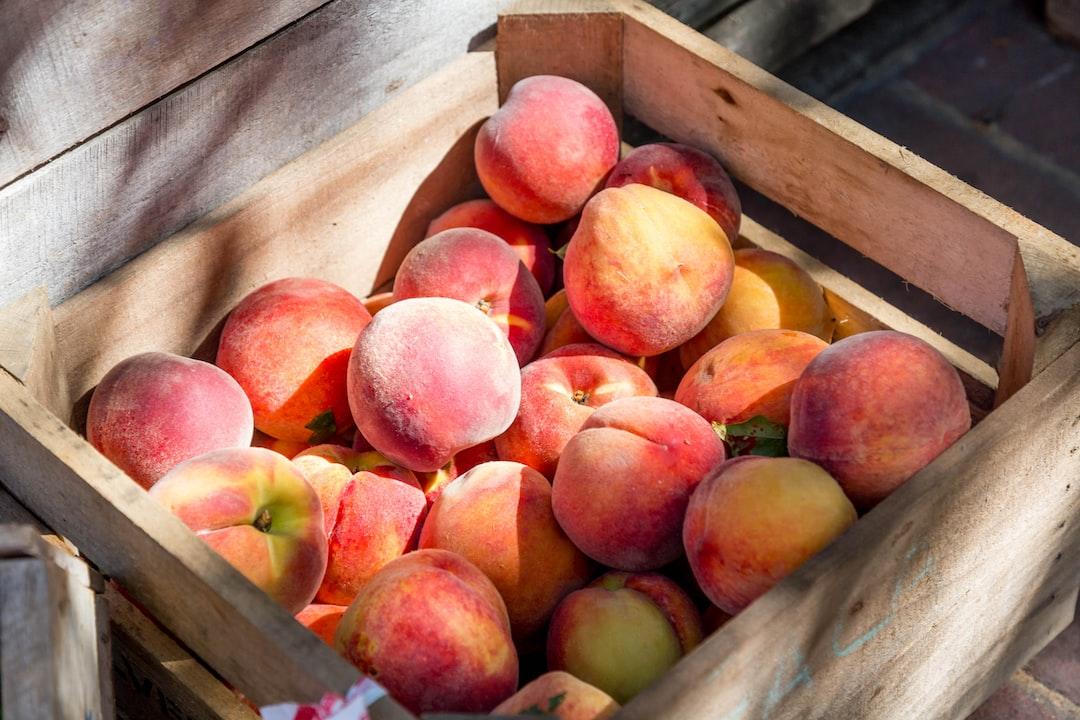 A yummy crate full of fresh Virginia peaches!
