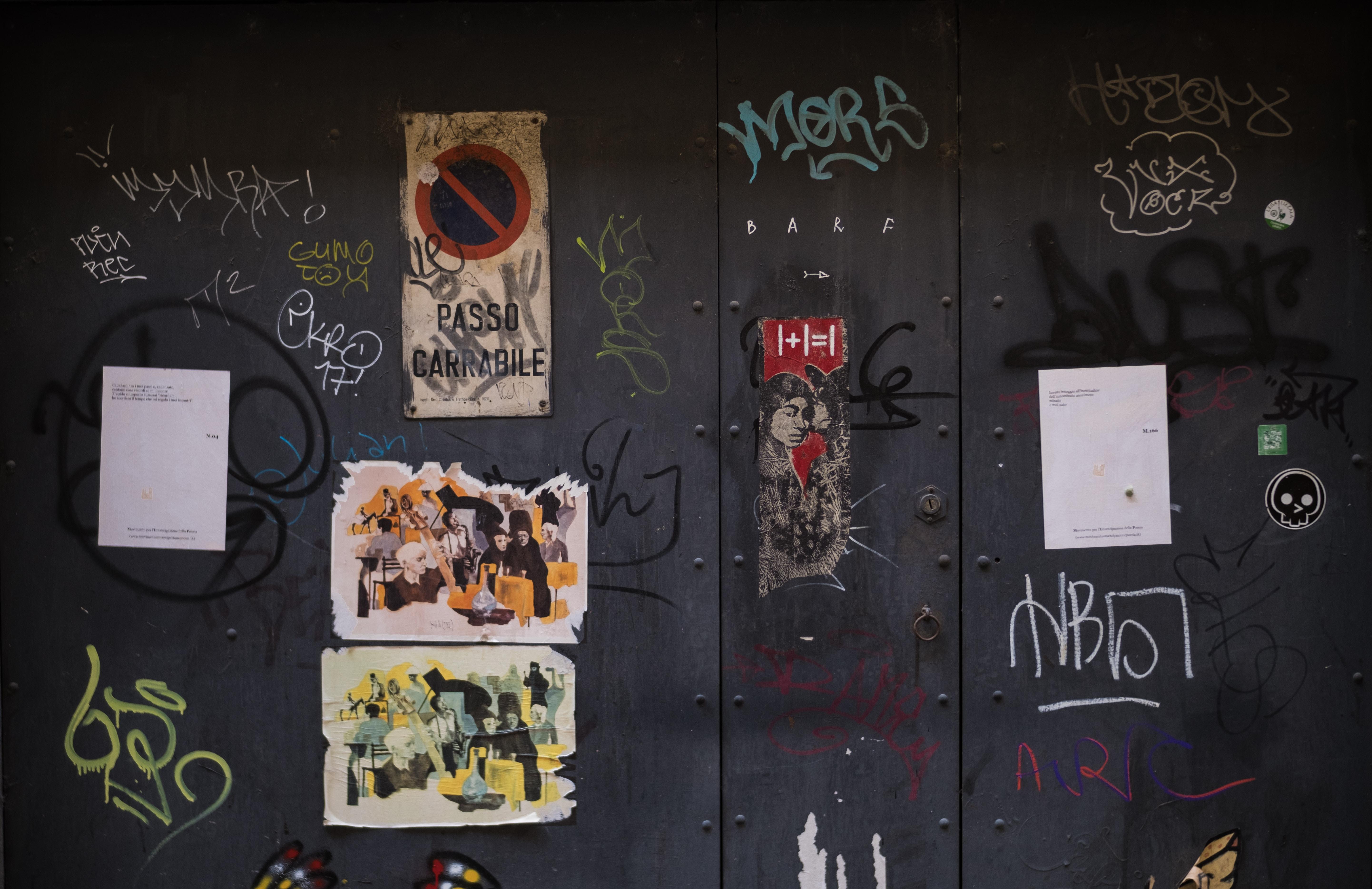 gray wall with graffiti