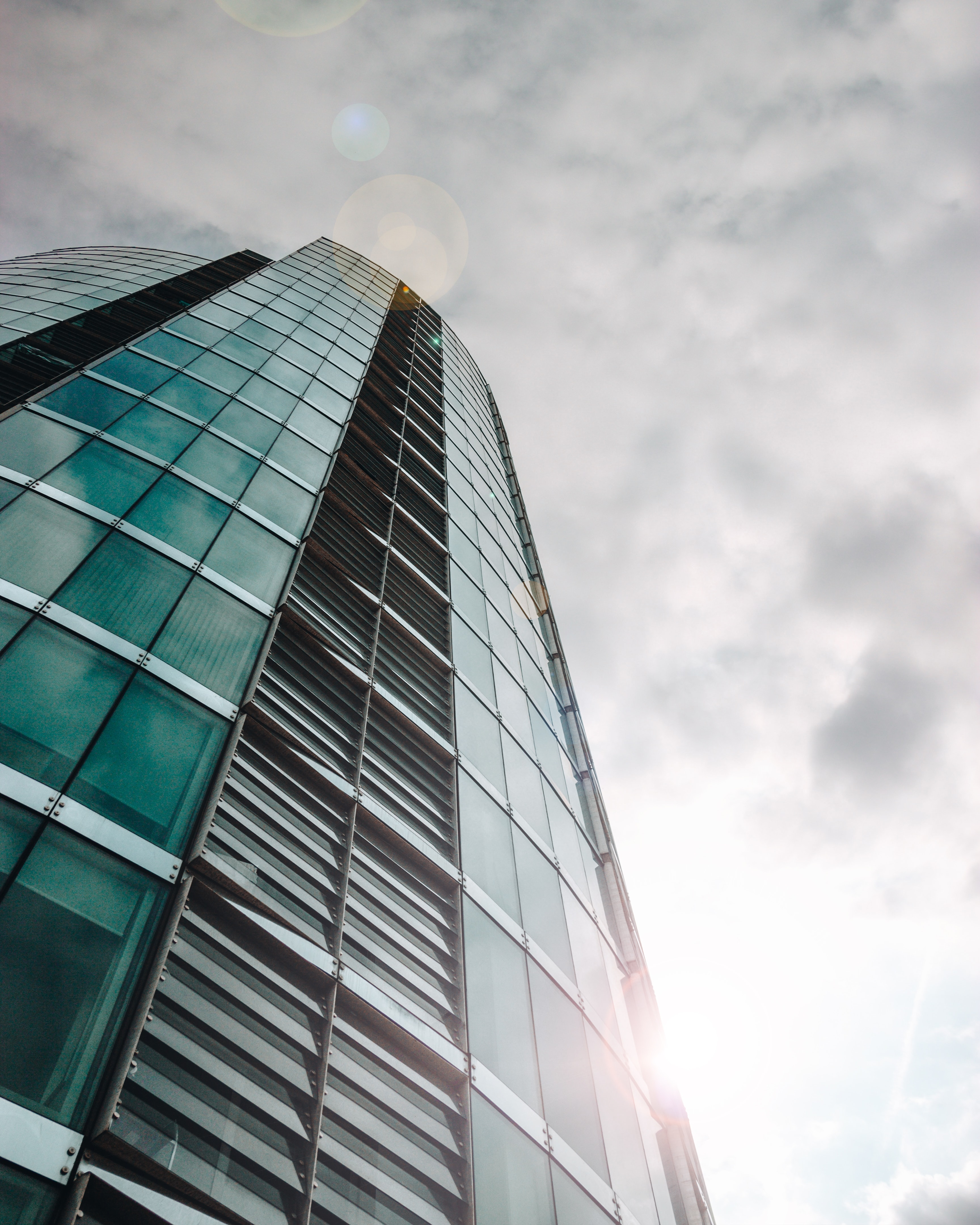 low-angle photography of gray glass concrete high-rise building