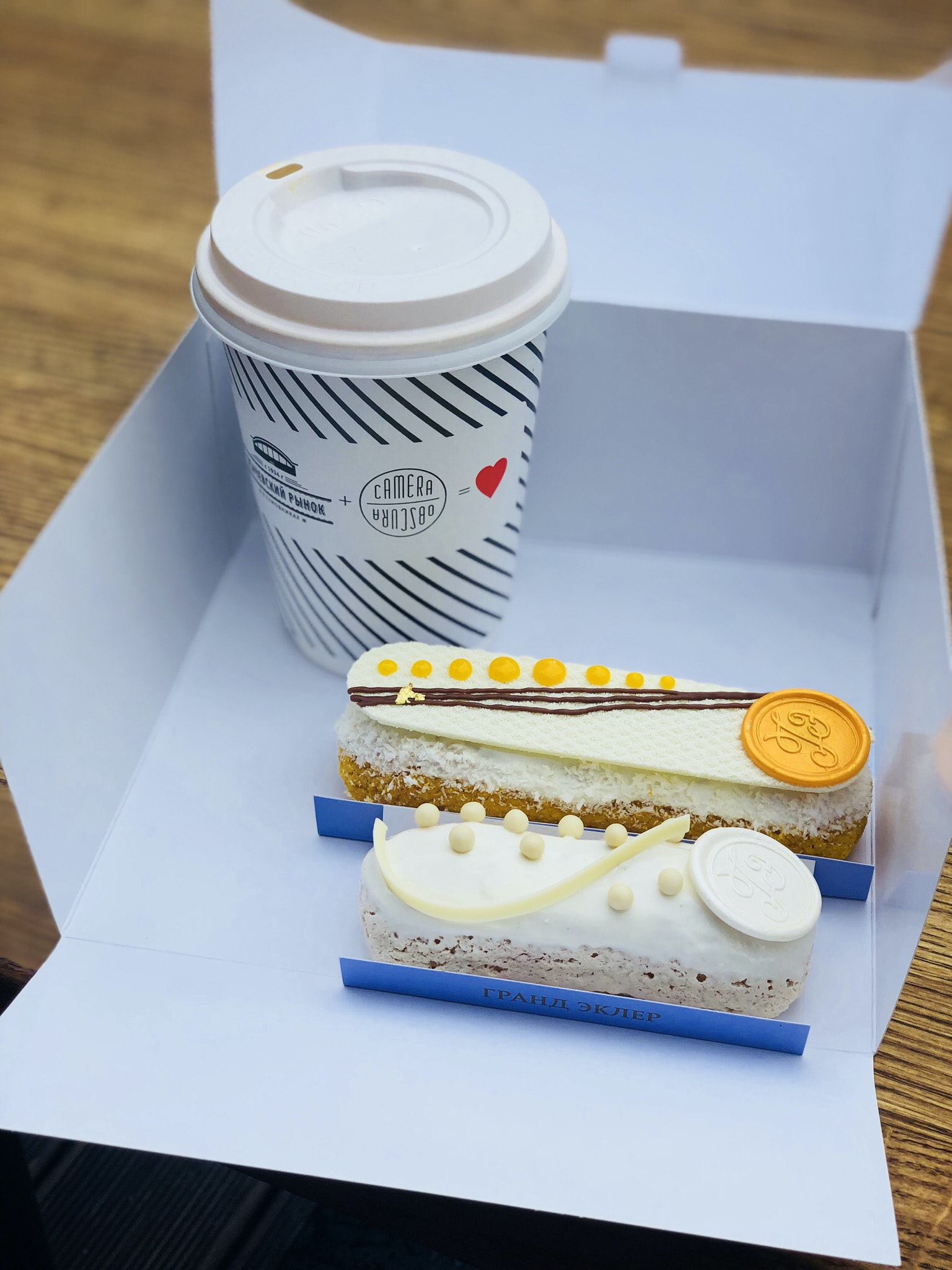 white disposable cup near cakes