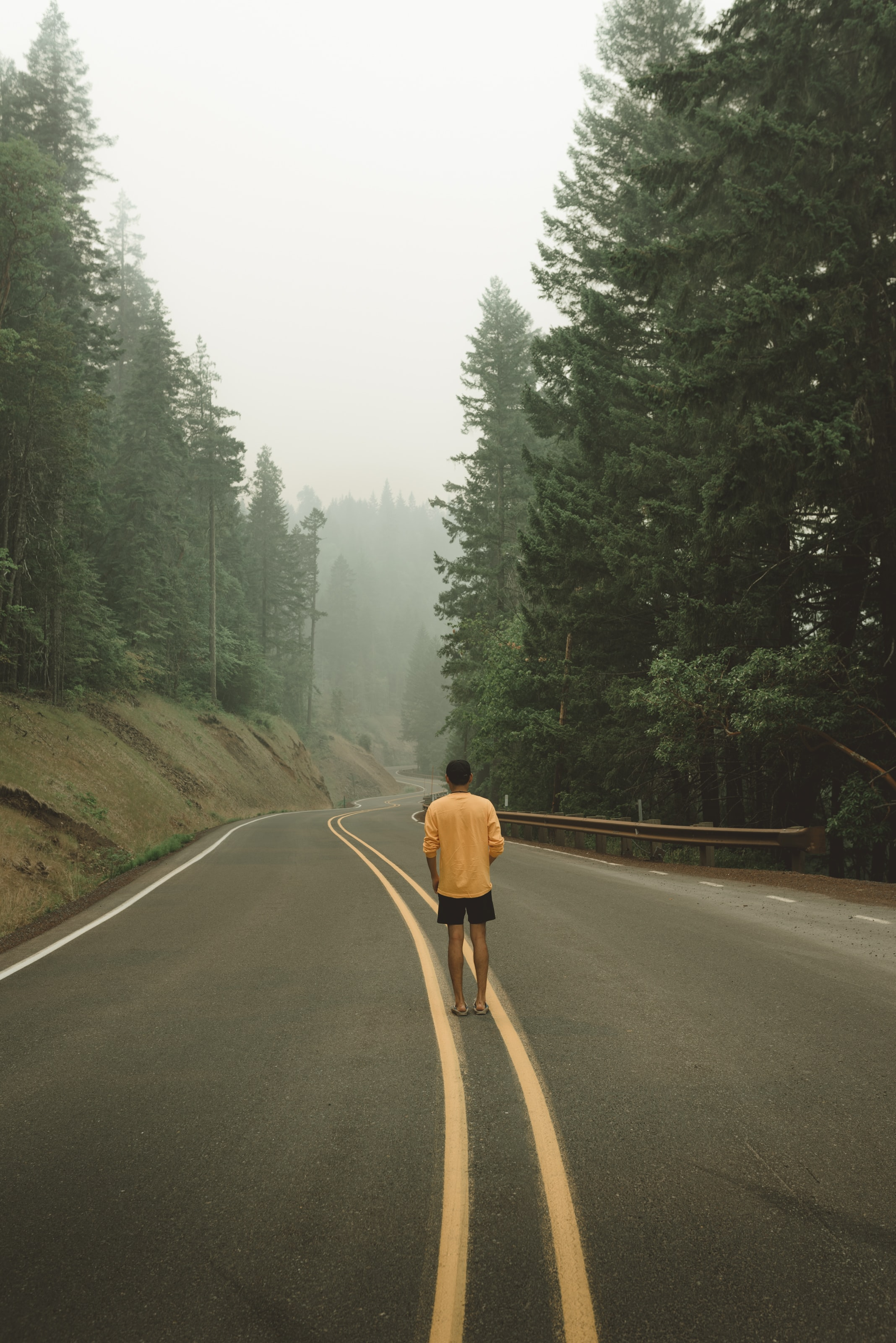 man standing at the center of the road