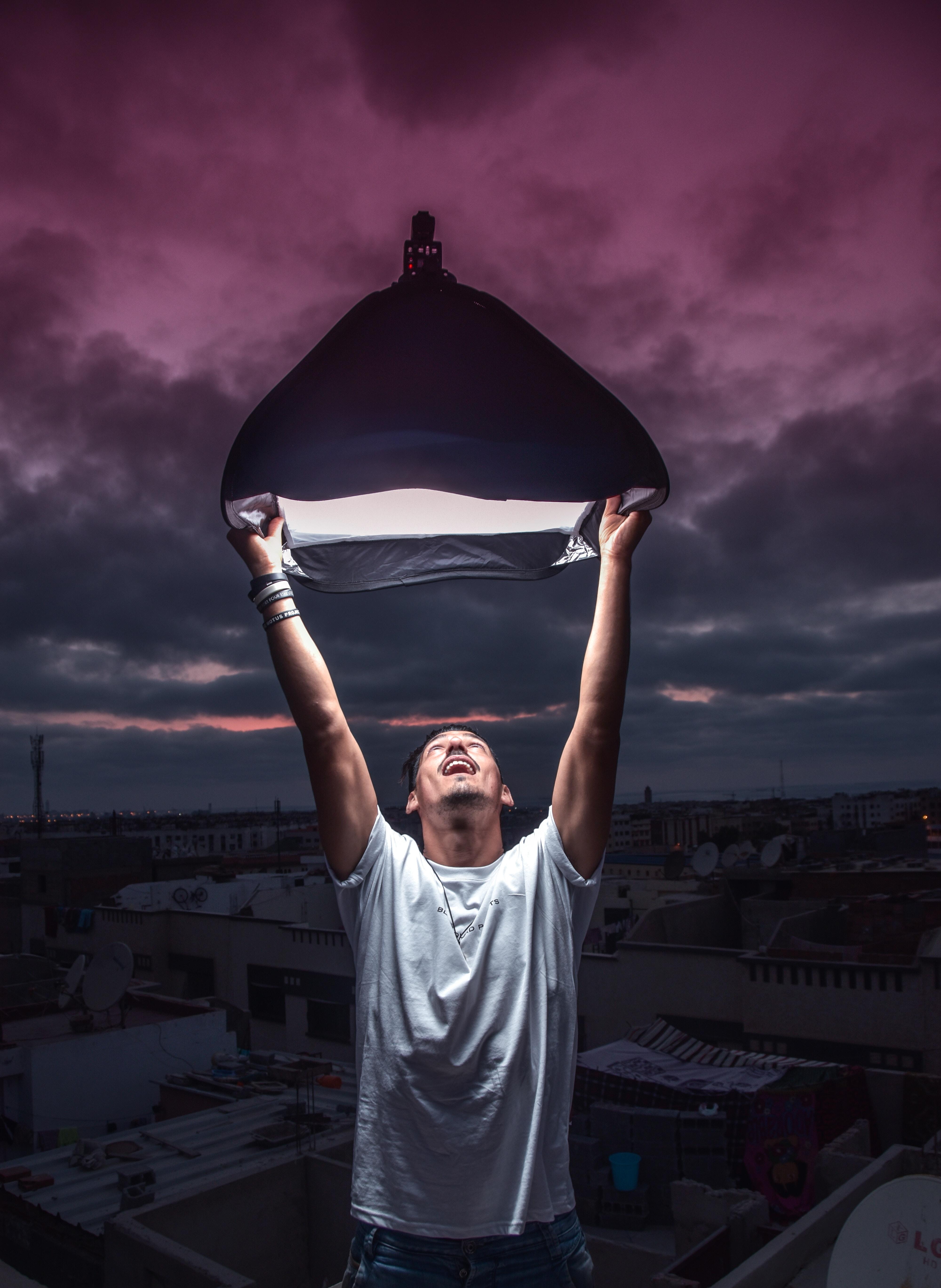 person holding black halogen light