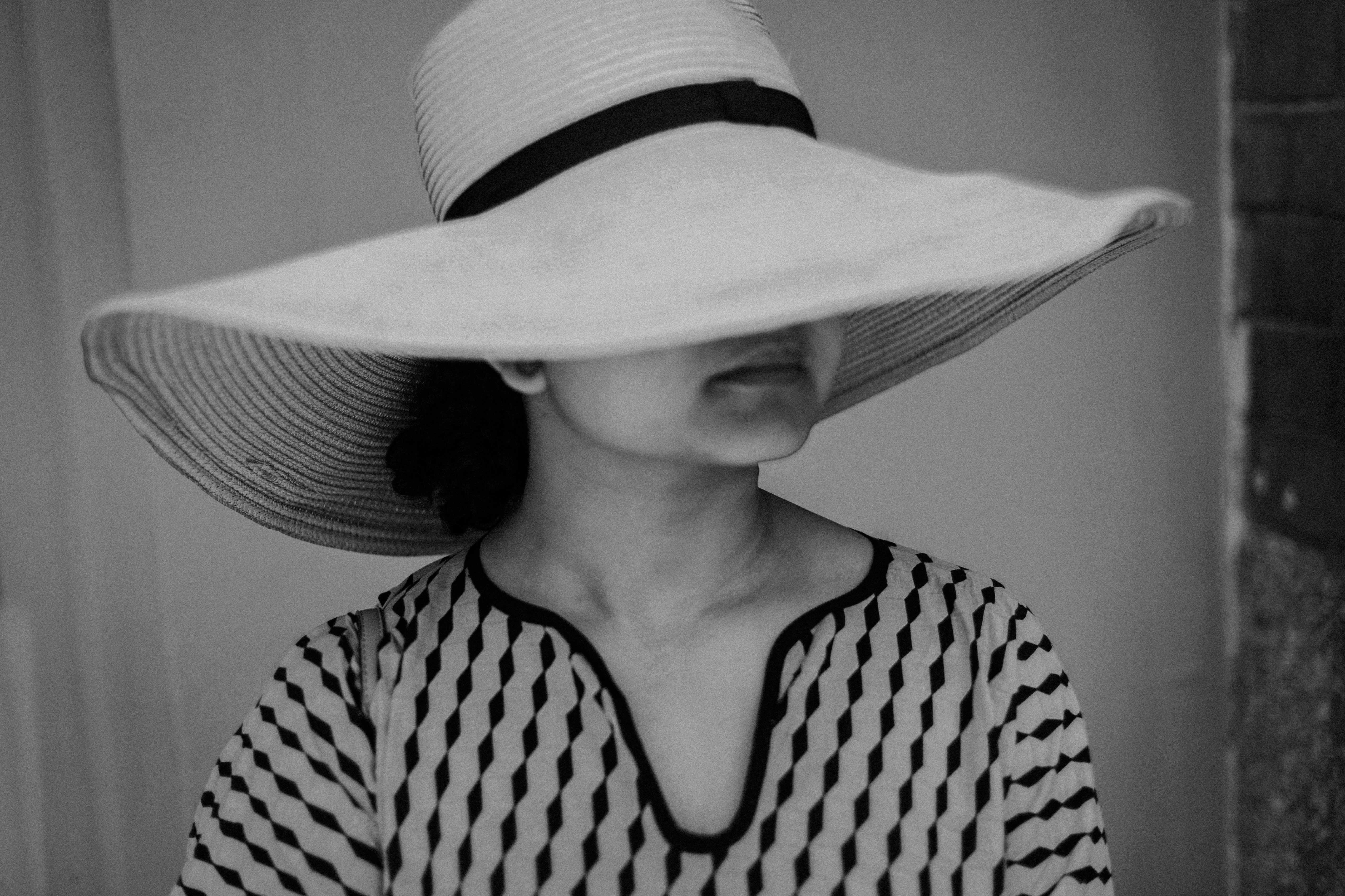 grayscale photo of woman wearing sun hat
