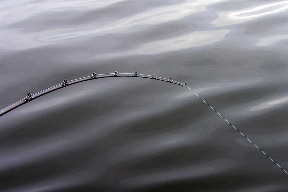 fishing rod greyscale photography
