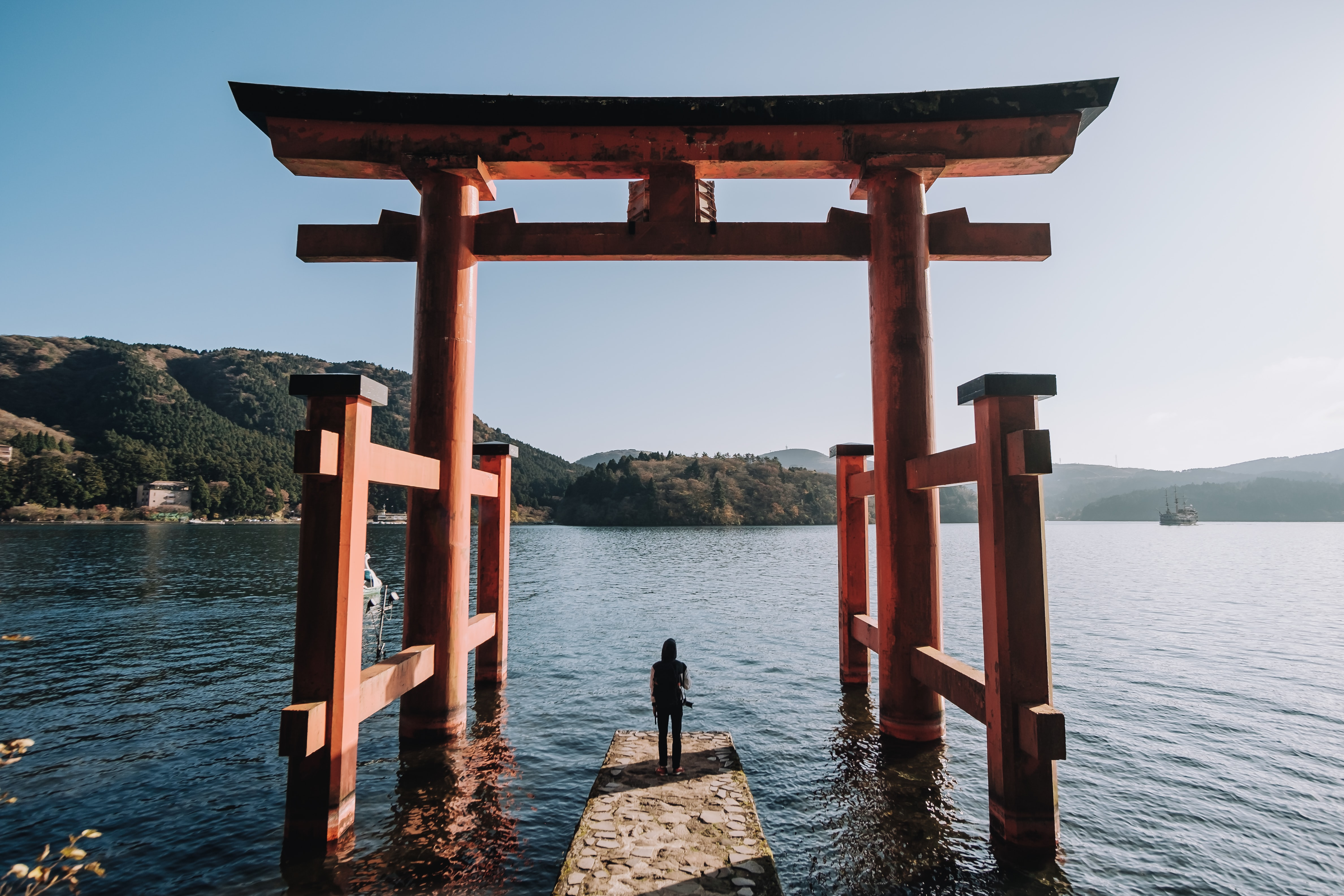 person standing in front of Torii Gate
