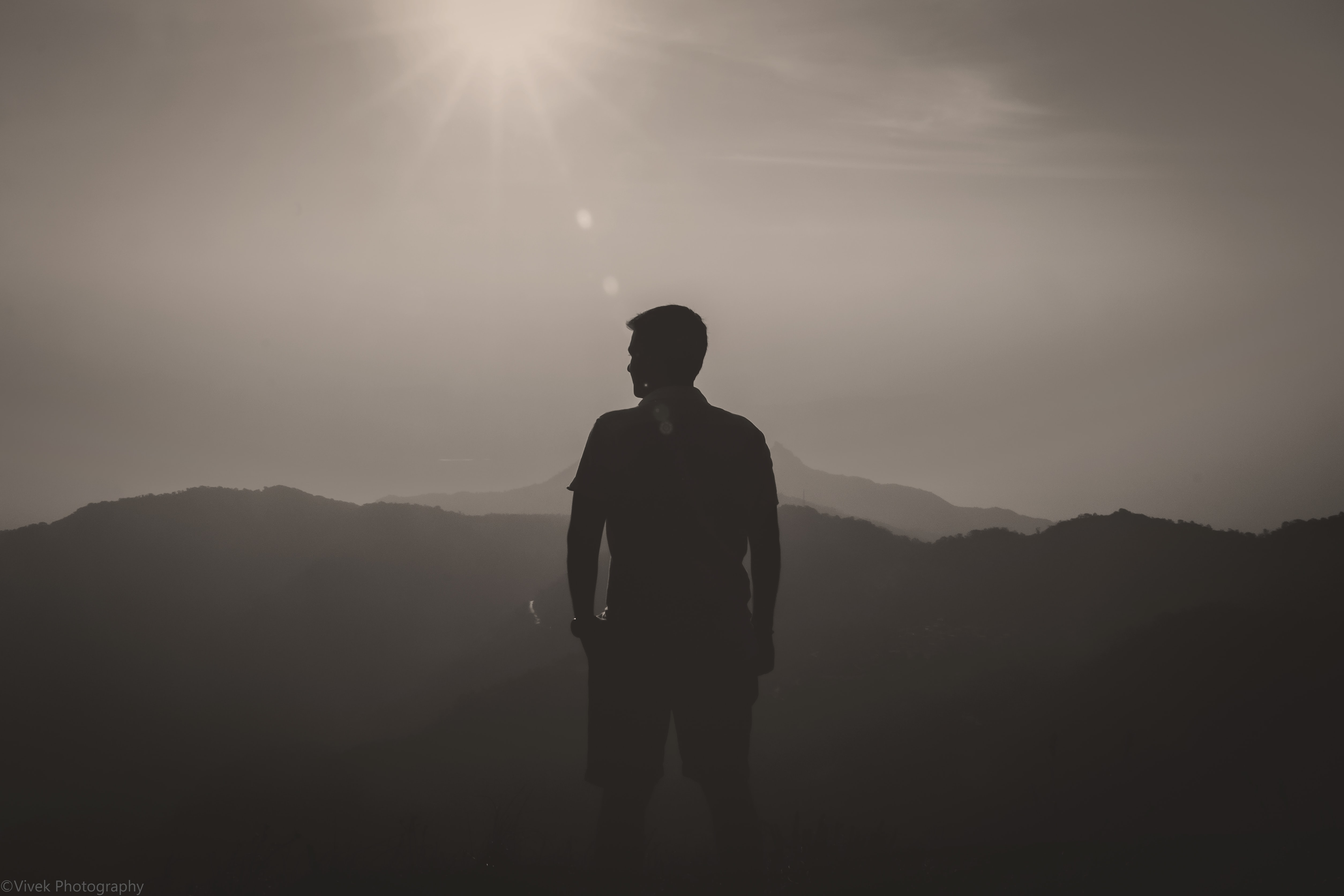 silhouette of man looking towards left