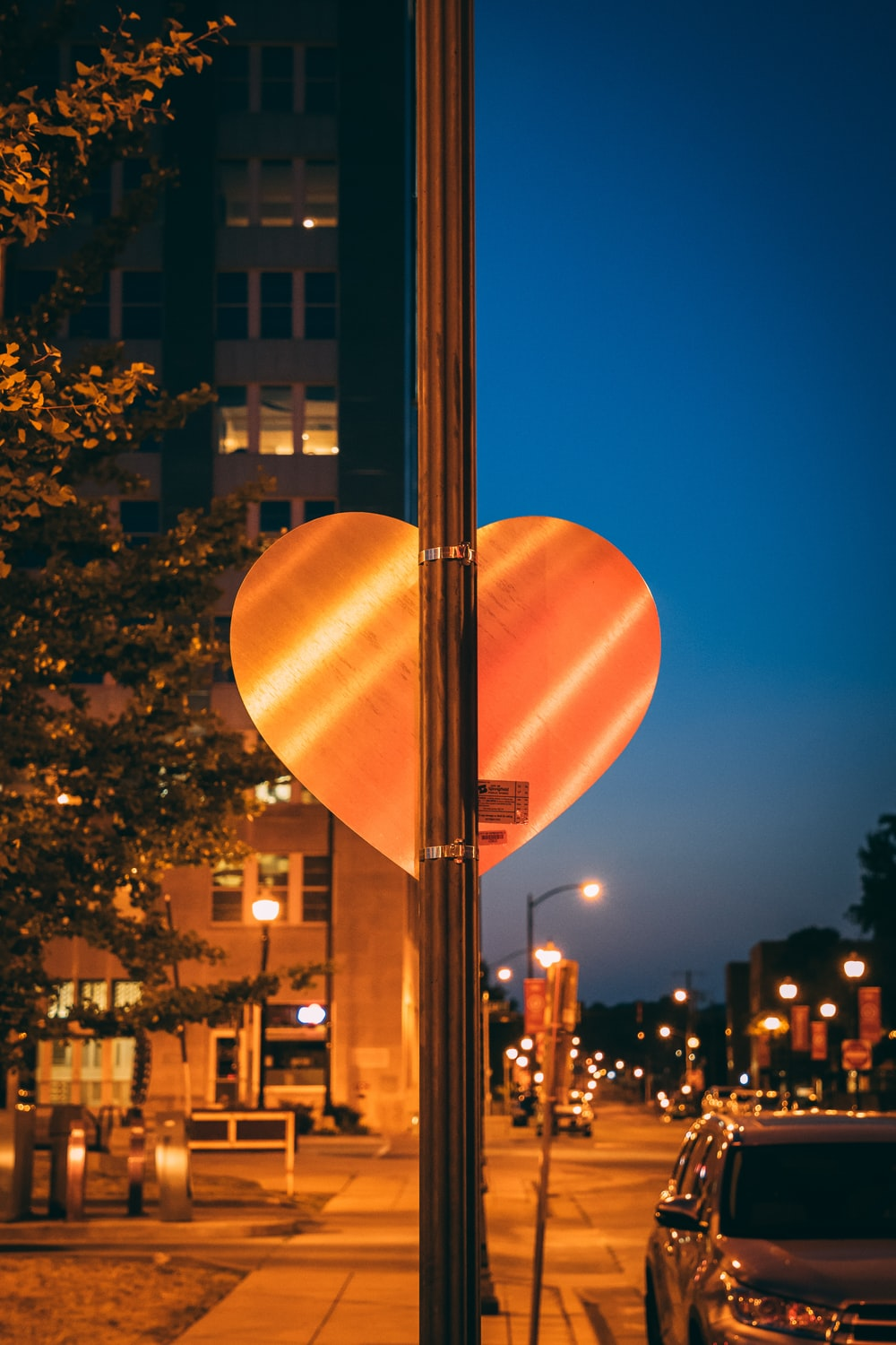 heart-shaped signage on lamp post
