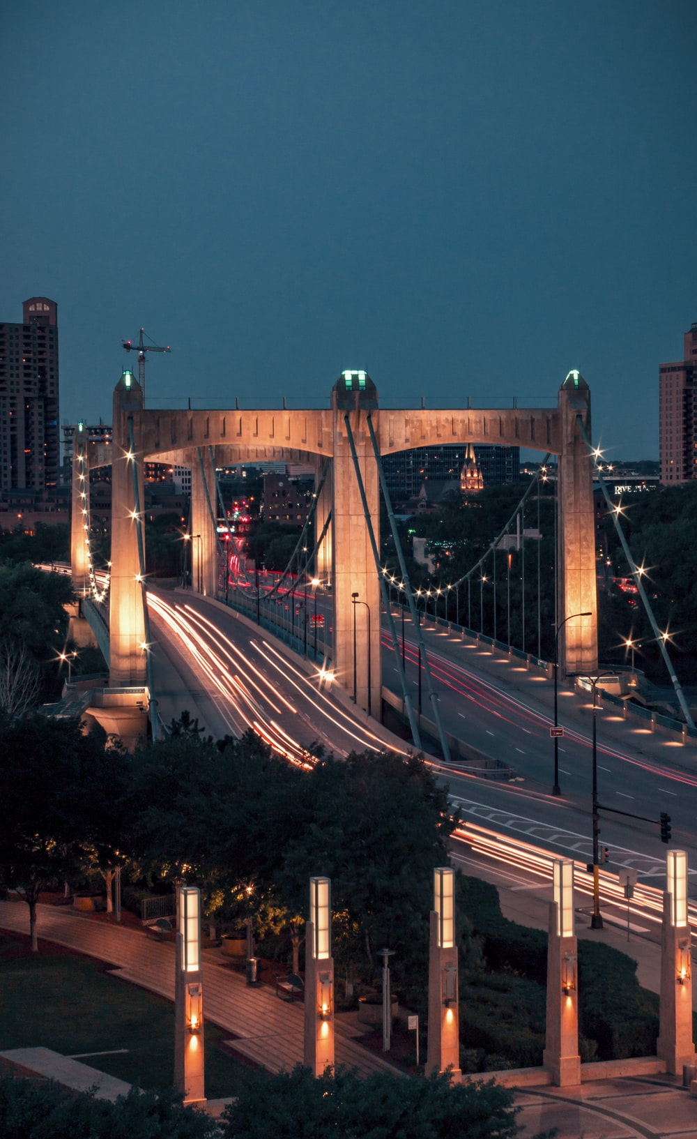 brown bridge during daytime time lapse photography