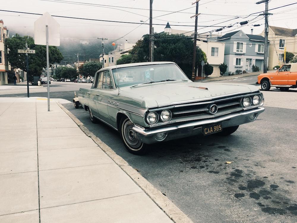 silver sedan parked near road side