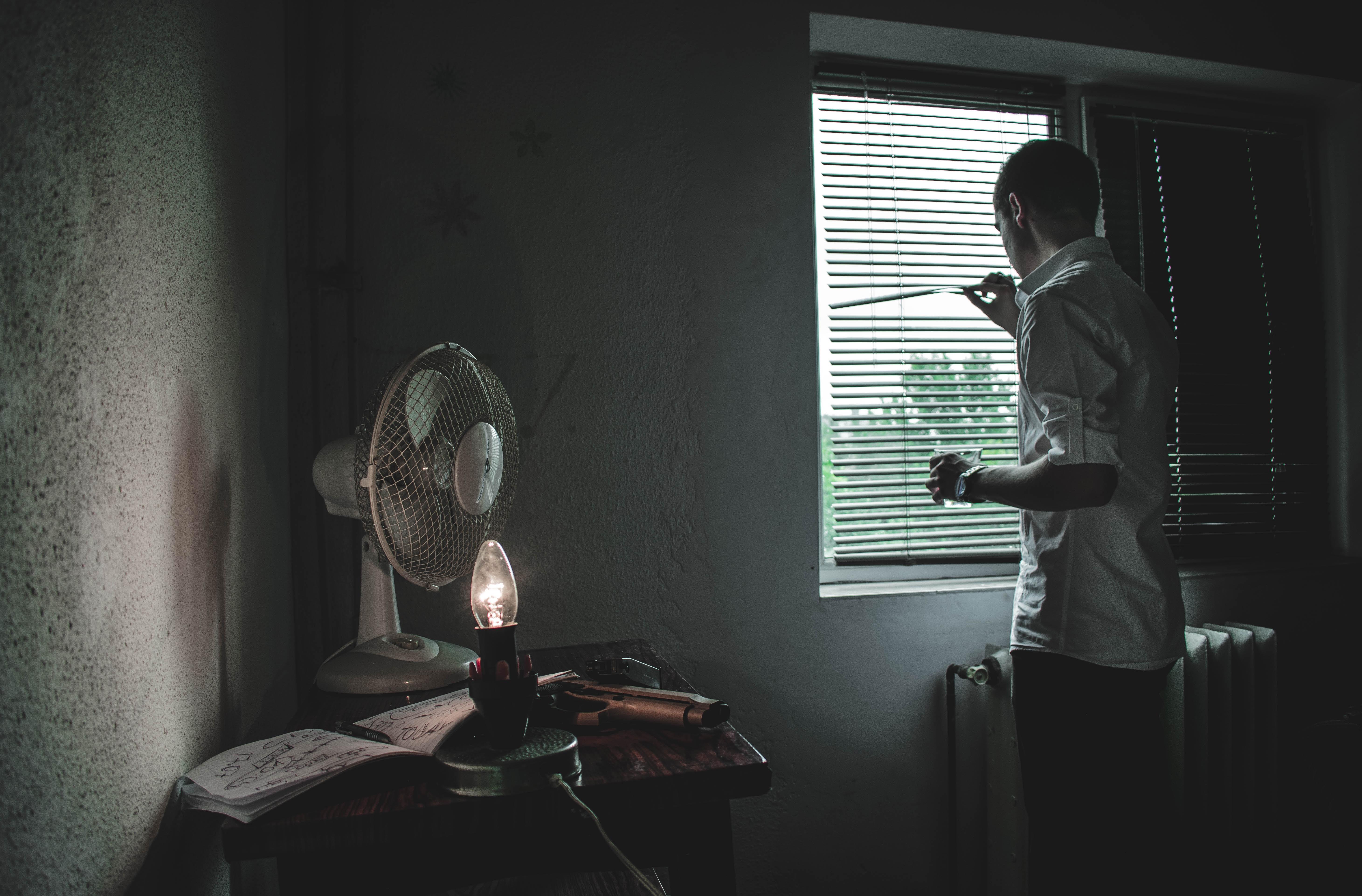 man next to window