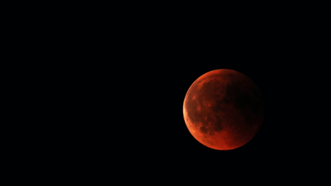 """Really struggled with my camera to take the picture. My equipment is definetly not made for capturing such a scene. Though, I am pretty happy with the result. Shot this on Juli 27th 2018 at 23:30 MEST. It was the night with the longest lunar eclipse of the 21st century at my location. At the same time the Mars was really near the Earth and appeared as bright orange/red """"star"""" just a little bit beneath the Moon. What a great night. Happy to was there, happy to be able to watch this spectacular phenomenon."""