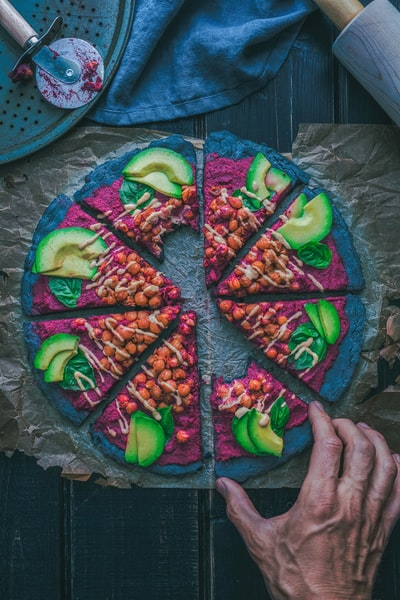 purple, green, and blue vegitable pizza