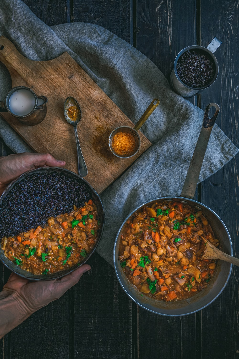 person holding pot with cook food