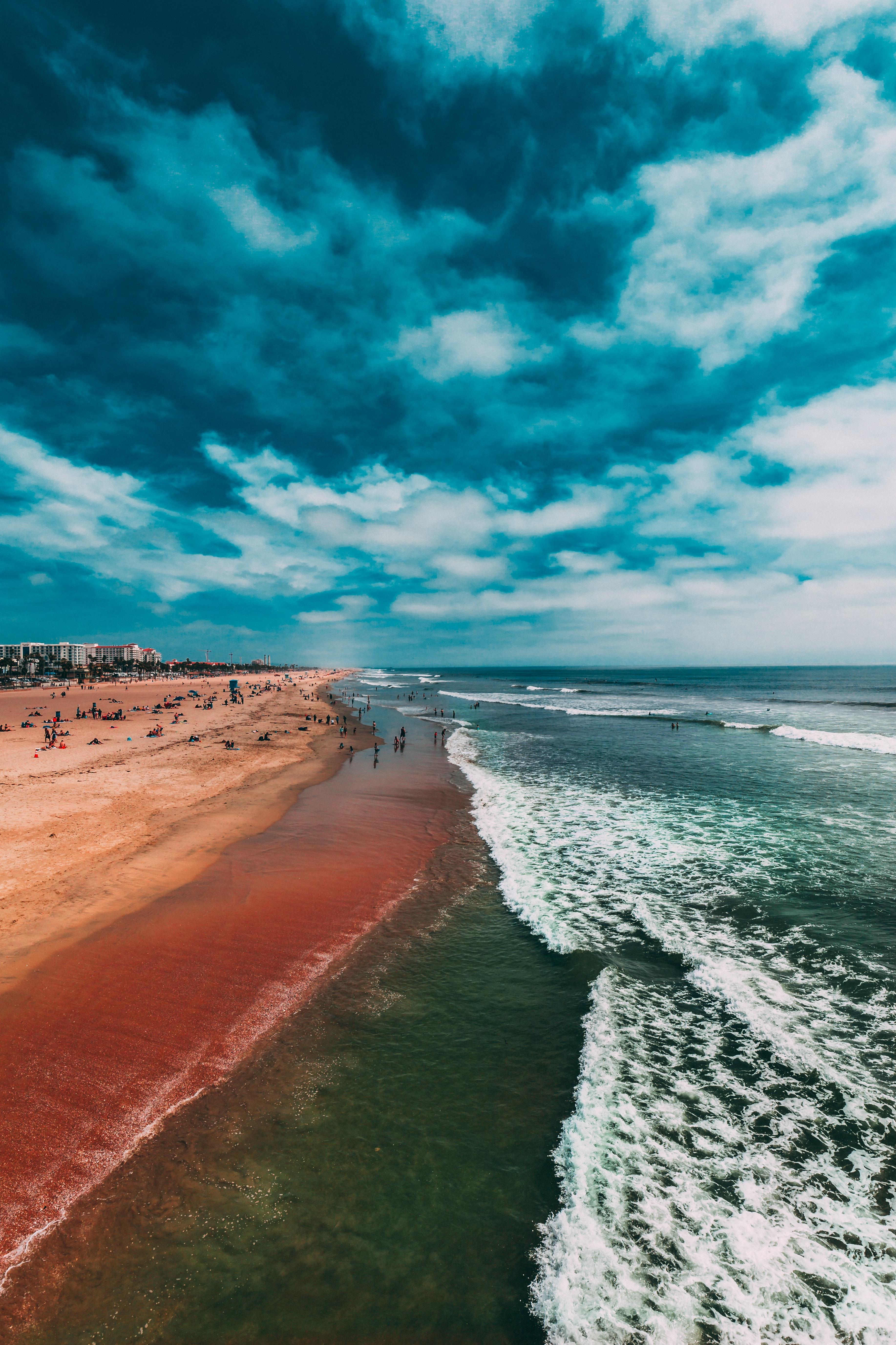 aerial photography of beach shore under teal sky