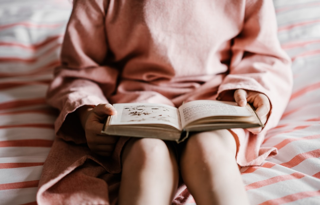 Girl reading a bedtime story book