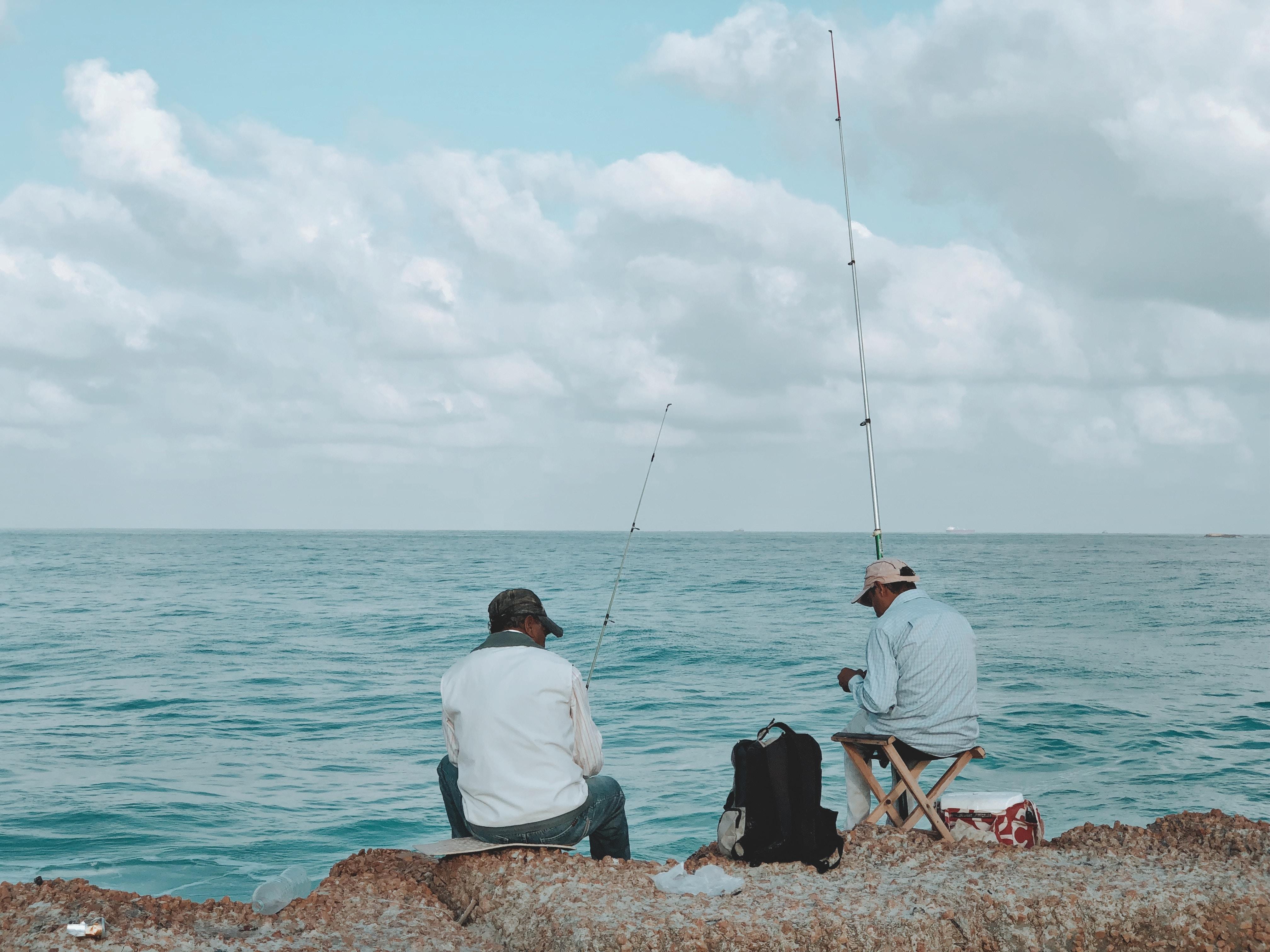 two man fishing on sea