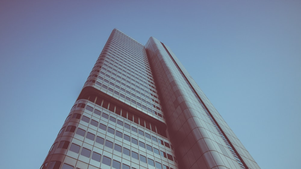 low angle photography of building under blue skies