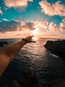 person next to ocean