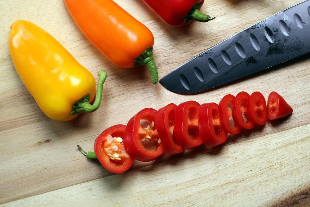 sliced red bell peppers on chopping board