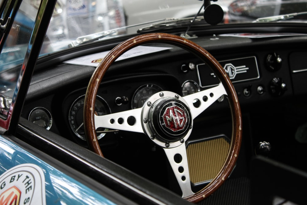 photo of brown and gray vehicle steering wheel during daytime